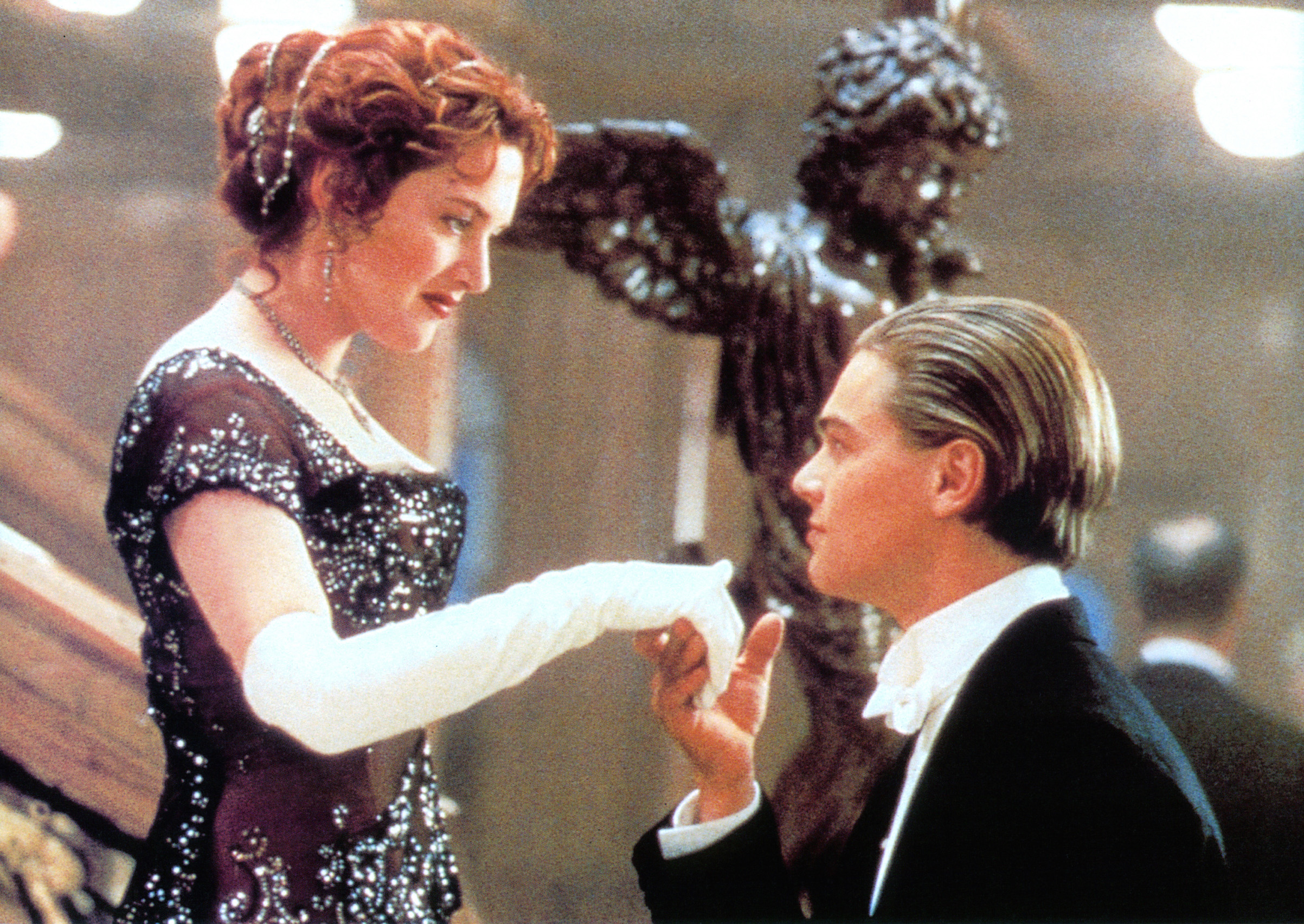 Kate Winslet offers her hand to Leonardo DiCaprio in a scene from the film Titanic, 1997.