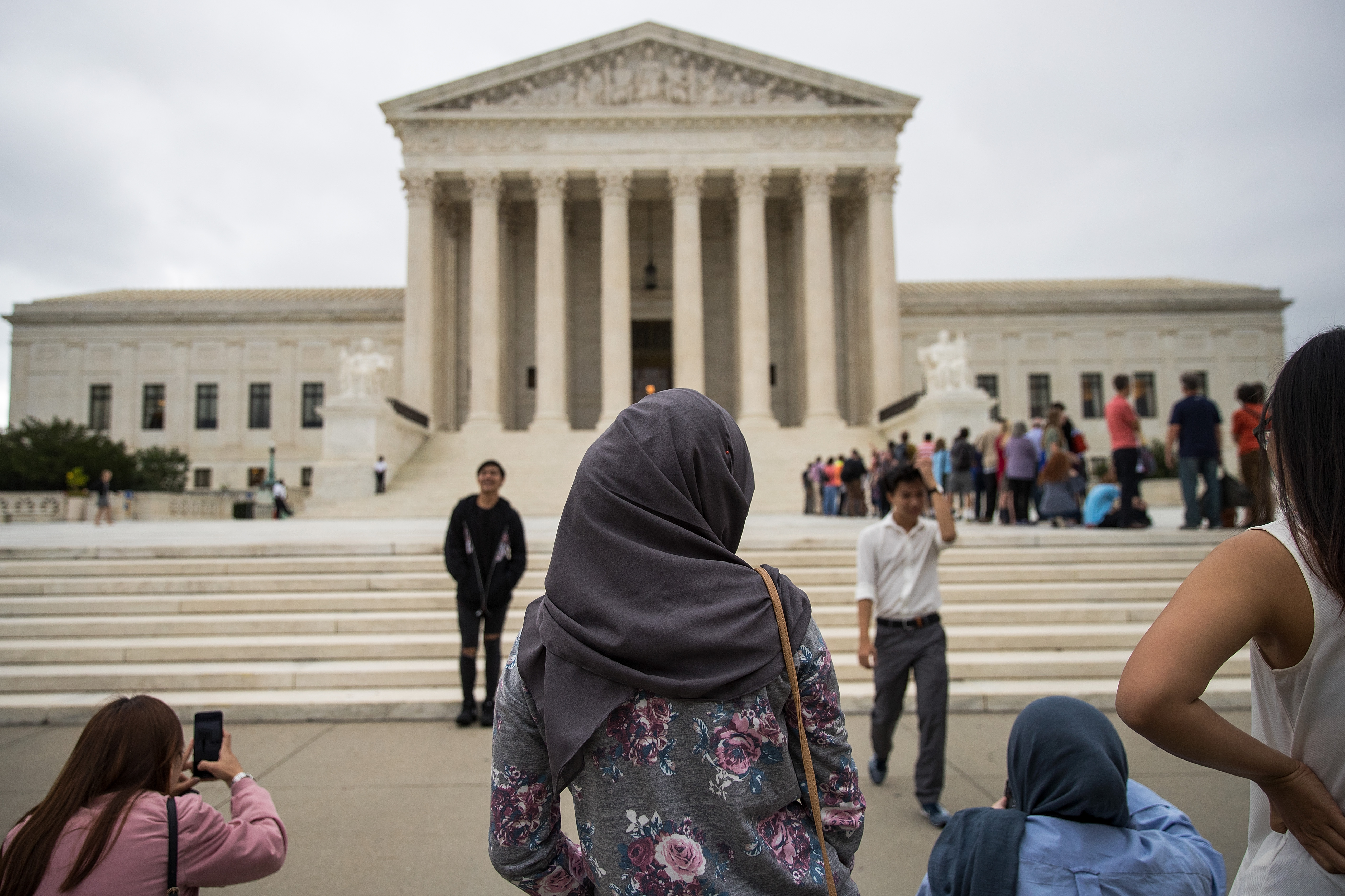 A woman wearing a hijab stands outside the U.S. Supreme Court, October 11, 2017 in Washington, DC.