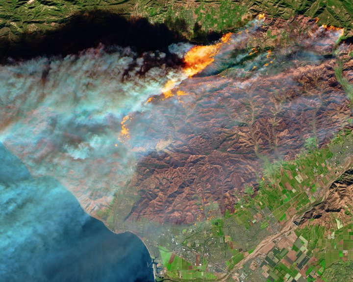 "On Dec. 5, 2017, the Multi Spectral Imager (MSI) on the European Space Agency's Sentinel-2 satellite captured the data for a false-color image of the burn scar in Ventura County, California. Active fires appear orange; the burn scar is brown. Unburned vegetation is green; developed areas are gray. The Sentinel-2 image is based on observations of visible, shortwave infrared, and near infrared light.The fires mainly affected a forested, hilly area north of Ventura, but flames have encroached into the northern edge of the city. On December 6, 2017, Cal Fire estimated that at least 12,000 structures were threatened by fire.Powerful Santa Ana winds fanned the flames. Forecasters with the Los Angeles office of the National Weather Service warned that the region is in the midst of its strongest and longest Santa Ana wind event of the year. They issued red flag warnings for Los Angles and Ventura counties through December 8, noting that isolated wind gusts of 80 miles (130 kilometers) per hour are possible.A prolonged spell of dry weather also primed the area for major fires. This week's winds follow nine of the driest consecutive months in Southern California history, NASA Jet Propulsion Laboratory climatologist Bill Patzert told the Los Angeles Times. ""Pile that onto the long drought of the past decade and a half, [and] we are in apocalyptic conditions,"" he said.Annotated images: NASA Earth ObservatoryNASA Earth Observatory images by Joshua Stevens using modified Copernicus Sentinel data (2017) processed by the European Space Agency"
