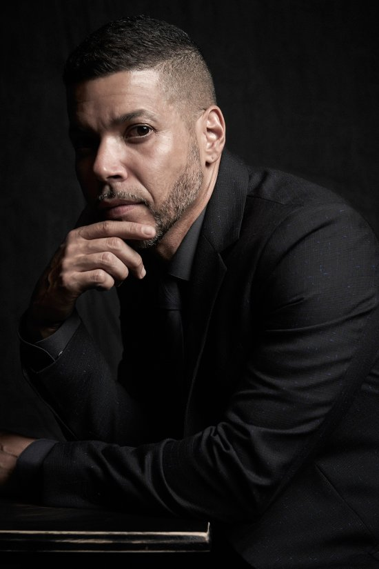 """Wilson Cruz poses for a portrait at Logo's """"Trailblazer Honors"""" on June 23, 2016, in the Cathedral of St. John the Divine in New York City."""