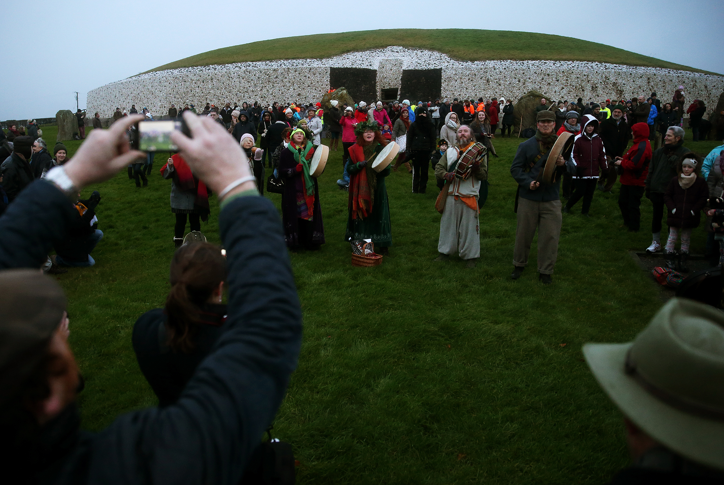 People gather for sunrise at Newgrange on the morning of the winter solstice on Dec. 21, 2014.