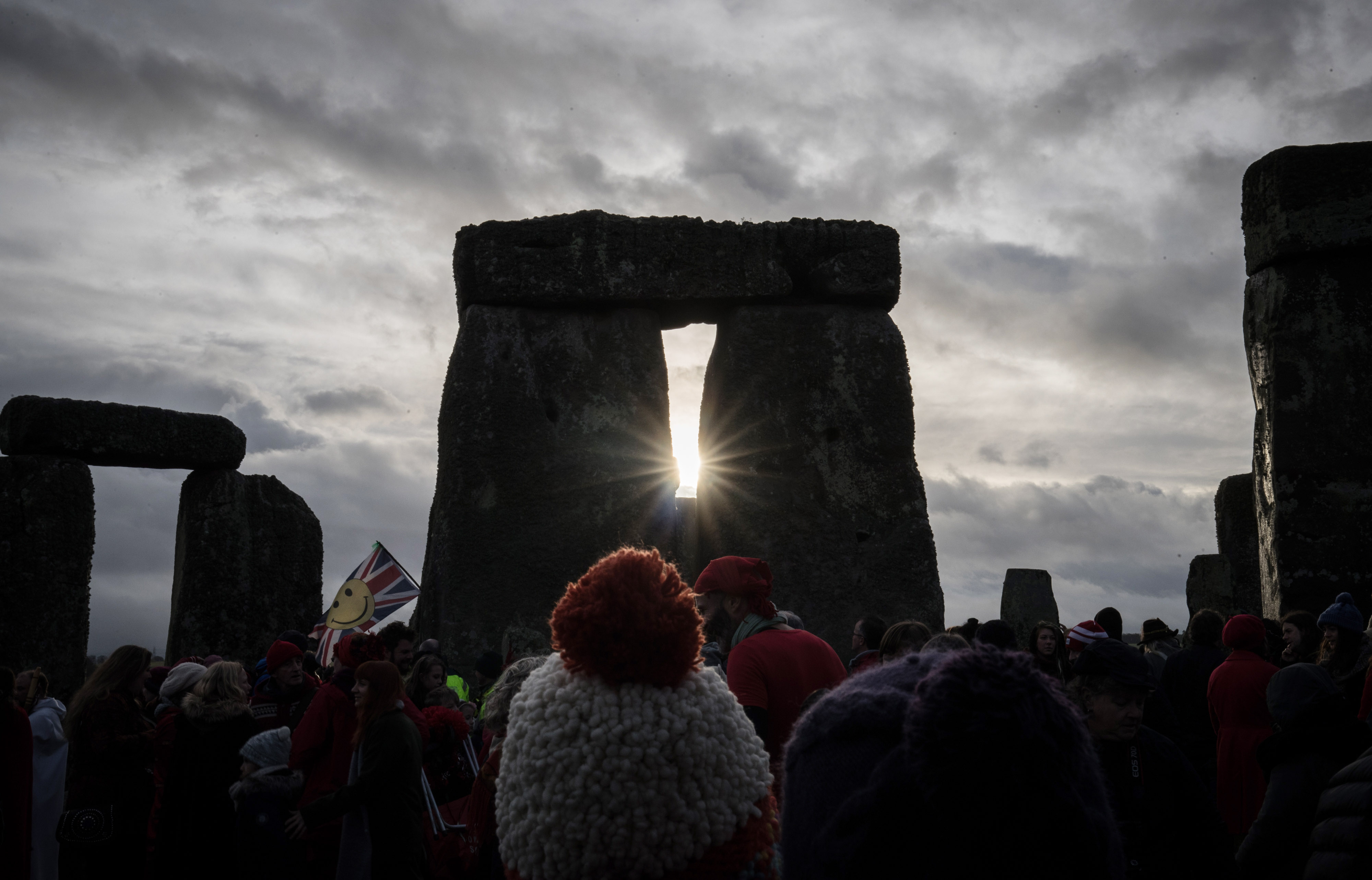 People look towards the sun as druids, pagans and revellers gather at Stonehenge, hoping to see the sun rise, as they take part in a winter solstice ceremony at the ancient neolithic monument of Stonehenge near Amesbury, in Wiltshire, England on Dec. 21, 2016.