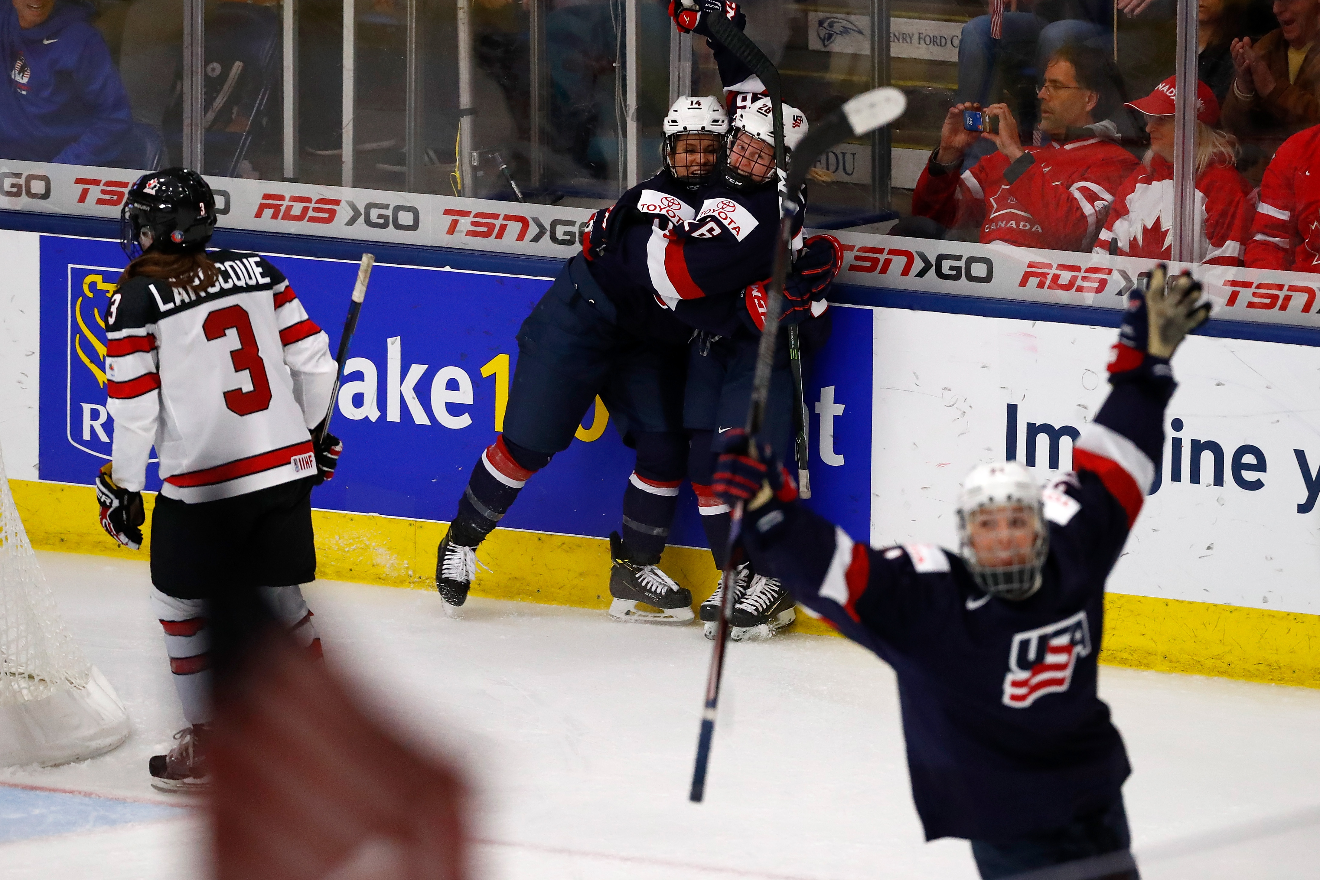 Brianna Decker #14 and Kendall Coyne #26 of the United States celebrate a game winning overtime goal at the 2017 IIHF Woman's World Championships at USA Hockey Arena on April 7, 2017 in Plymouth, Michigan. Gregory Shamus—Getty Images.