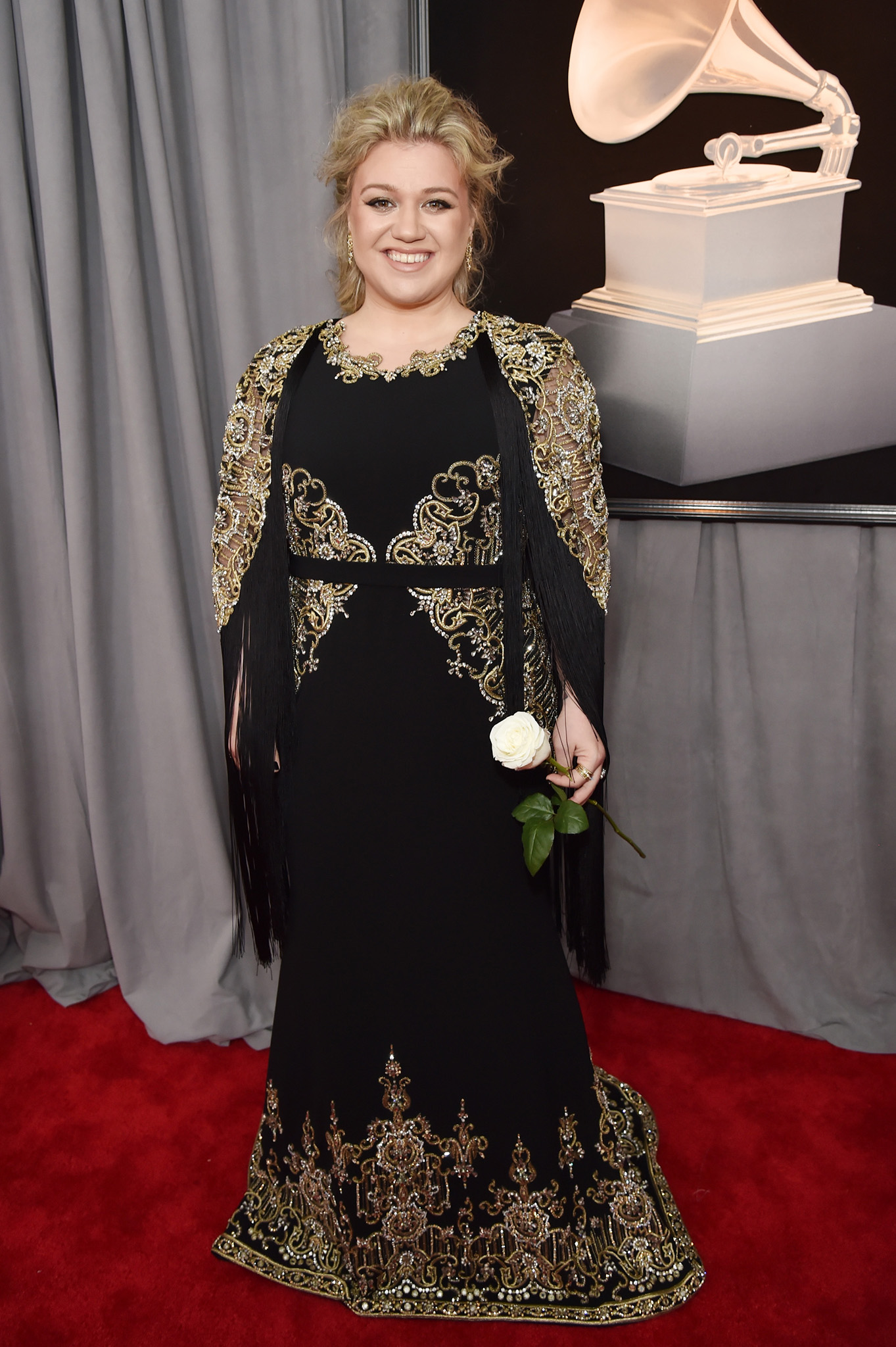 Recording artist Kelly Clarkson, white rose detail, attends the 60th Annual GRAMMY Awards at Madison Square Garden on January 28, 2018 in New York City.