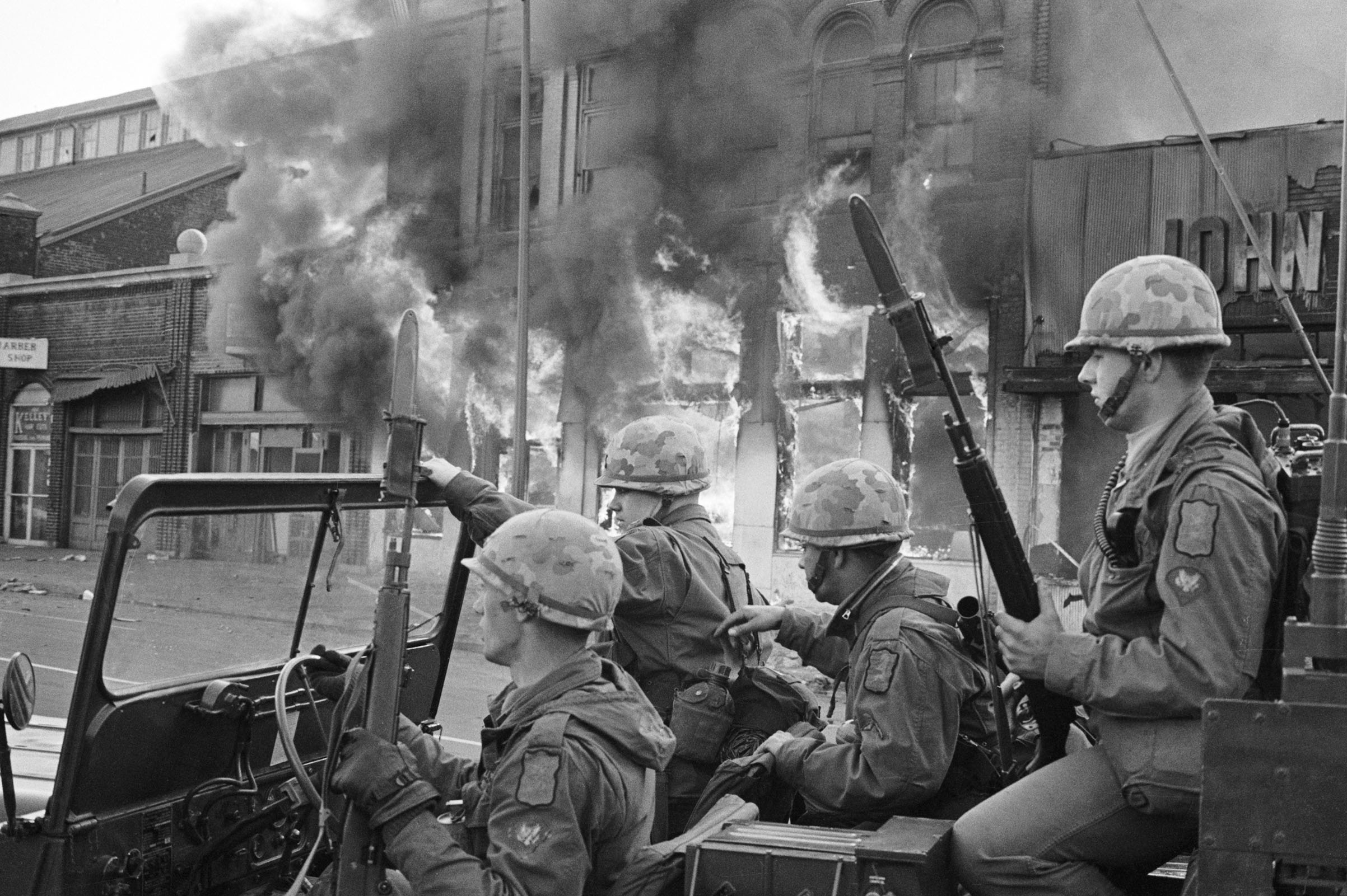 Troops were on patrol as protests and arson roiled Washington after the assassination of Martin Luther King Jr.