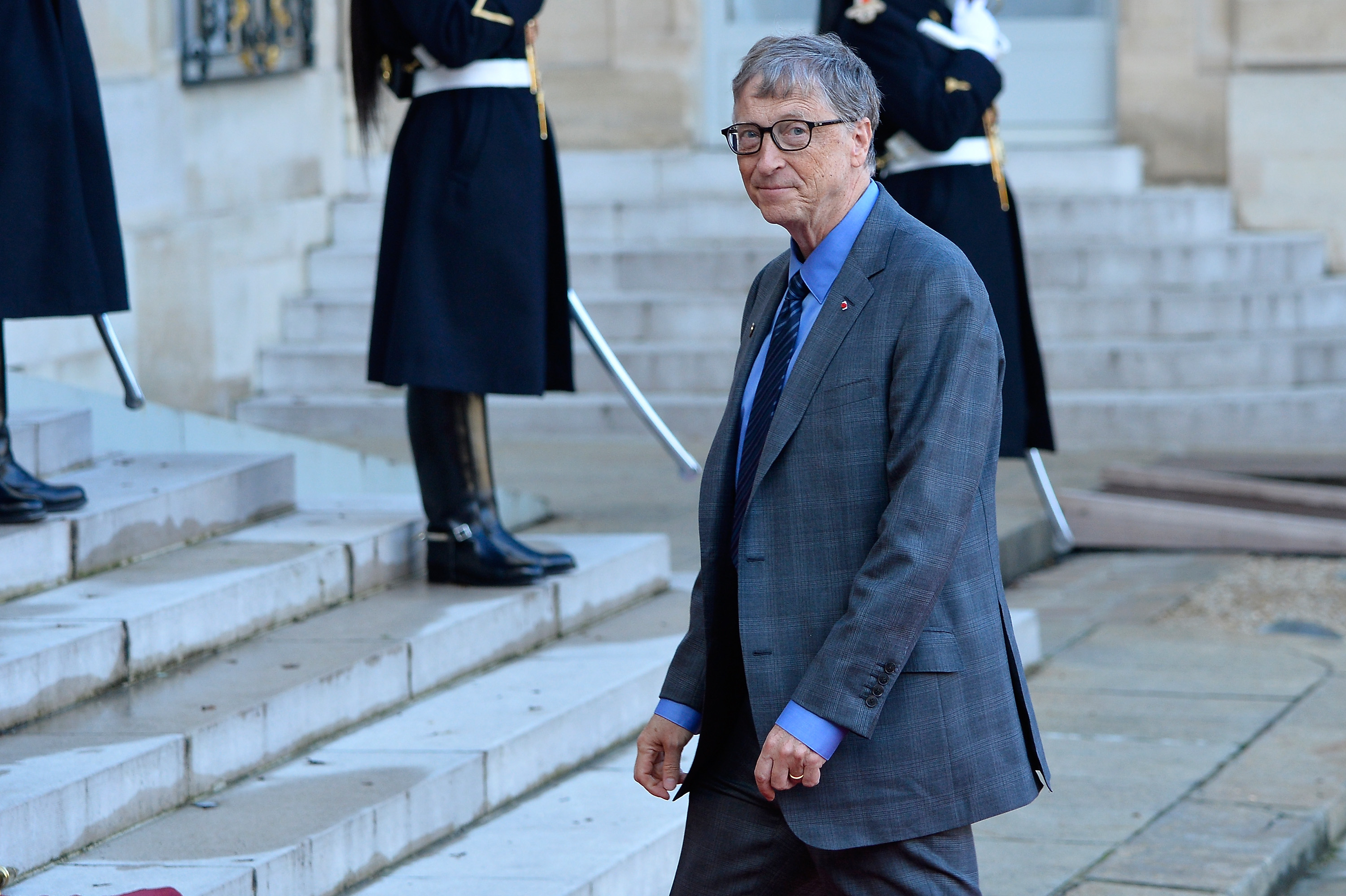 Bill Gates arrives for a meeting with French President Emmanuel Macron as he receives the One Planet Summit's international leaders at Elysee Palace on December 12, 2017 in Paris, France. Macron is hosting the One climate summit, which gathers world leaders, philantropists and other committed private individuals to discuss climate change.