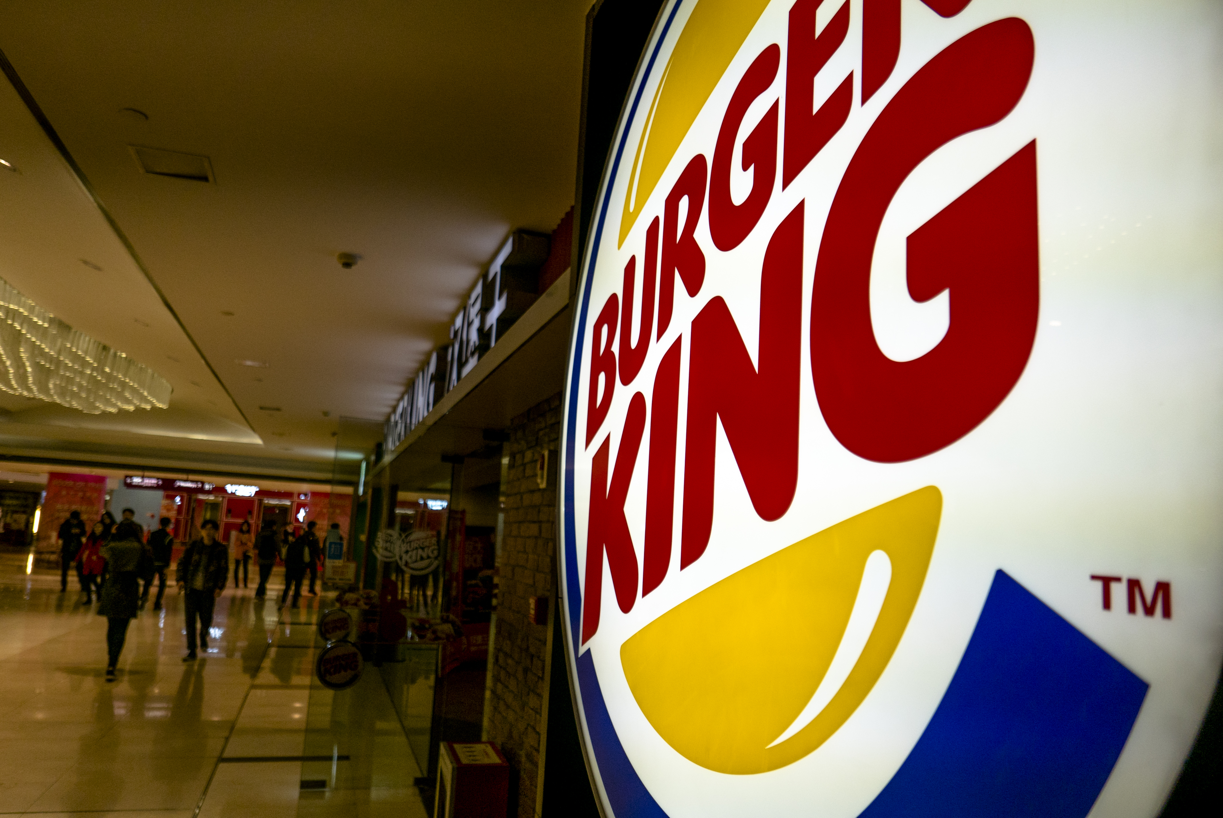 Lightbox logo of Burger King in a shopping mall