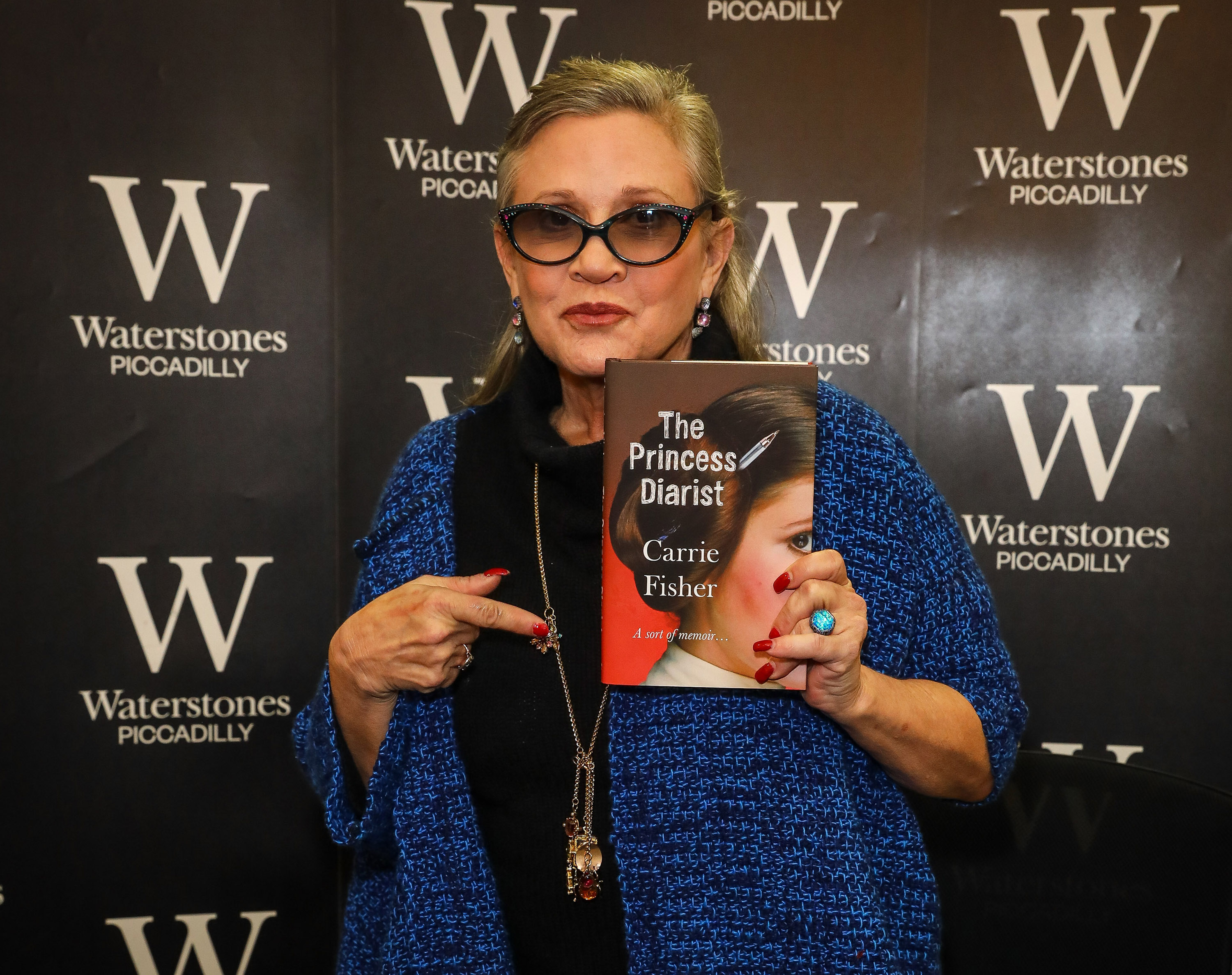 Carrie Fisher signs copies of her new book  The Princess Diarist  at Waterstones, Piccadilly, on December 11, 2016 in London, England.