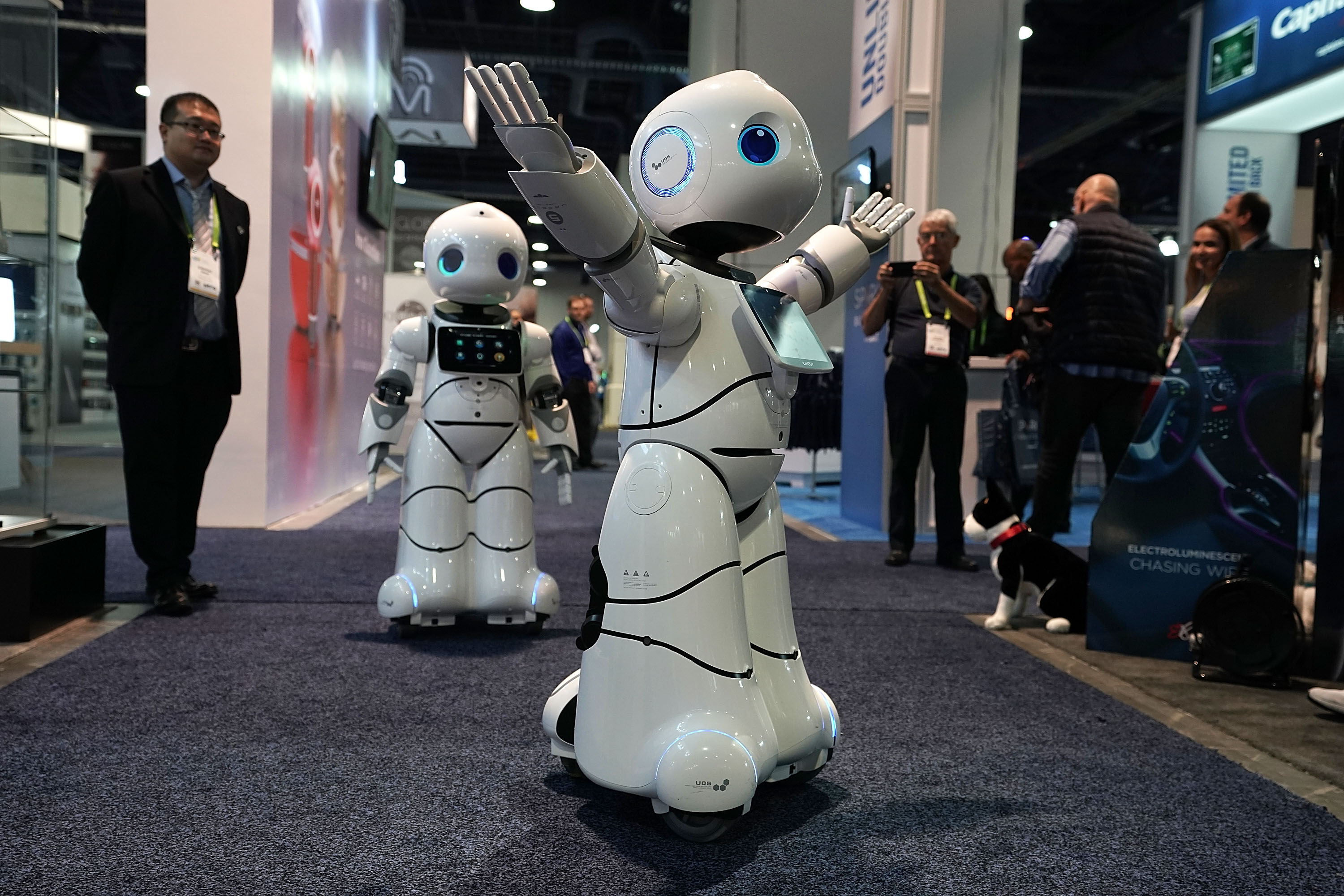 The U-Partner U05 humanoid service robots by Canbot, featured with free speech interaction, microsecond-level face recognition, autonomous obstacle avoidance walking, bionic action control and smart home hub, greet attendees during CES 2018 at the Las Vegas Convention Center on January 11, 2018 in Las Vegas, Nevada.