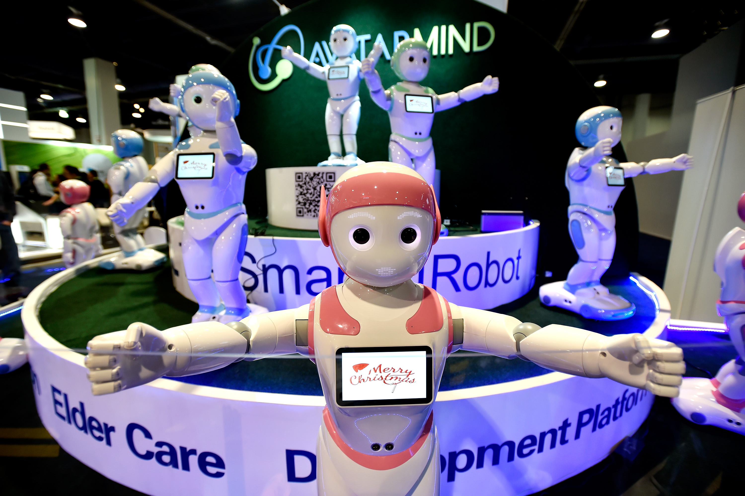 A chorus of iPal robots sing for attendees at the AvatarMind booth during CES 2018 at the Las Vegas Convention Center on January 10, 2018 in Las Vegas, Nevada.