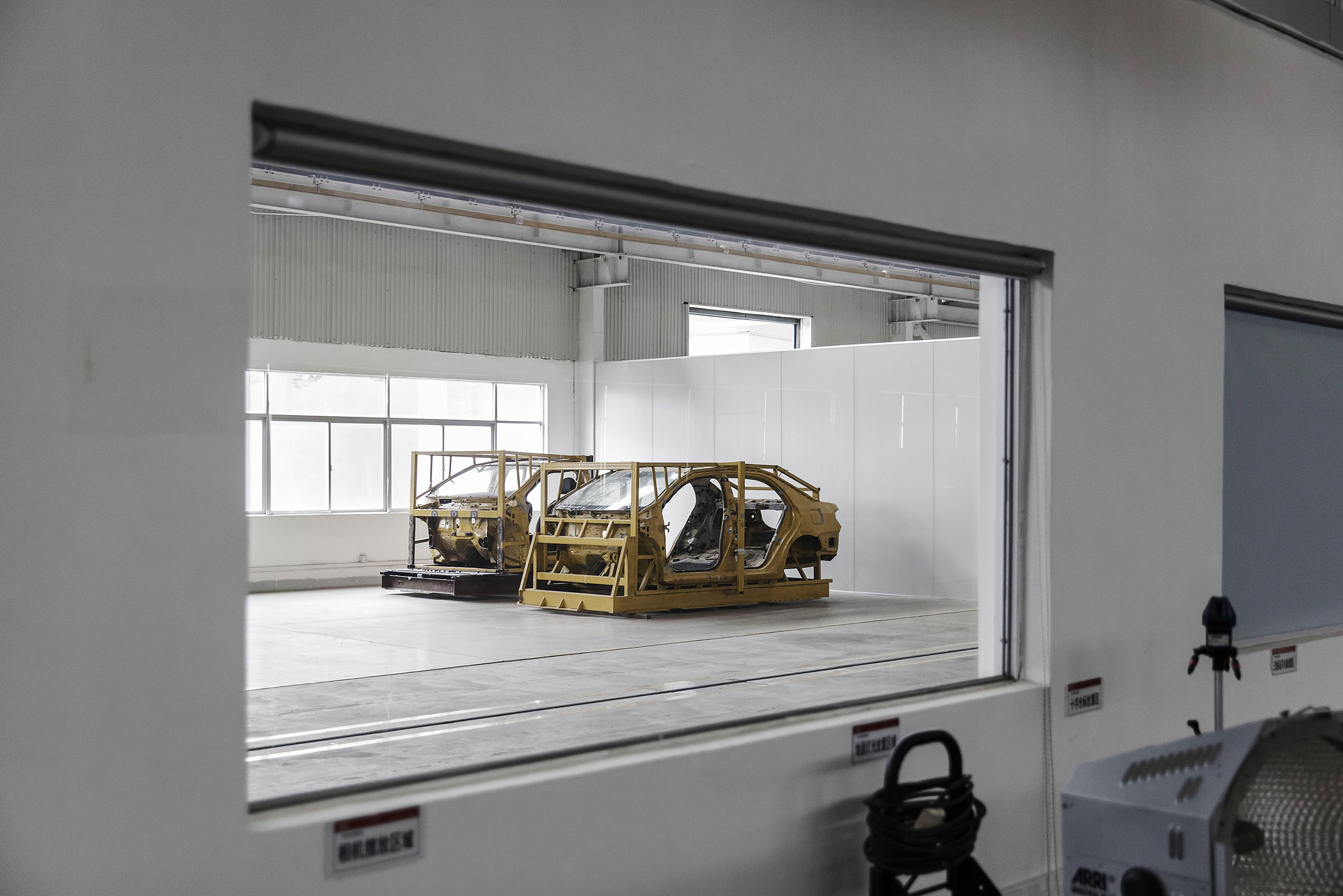 Vehicle frames await testing in leading car­maker BYD's lab in Shenzhen, China