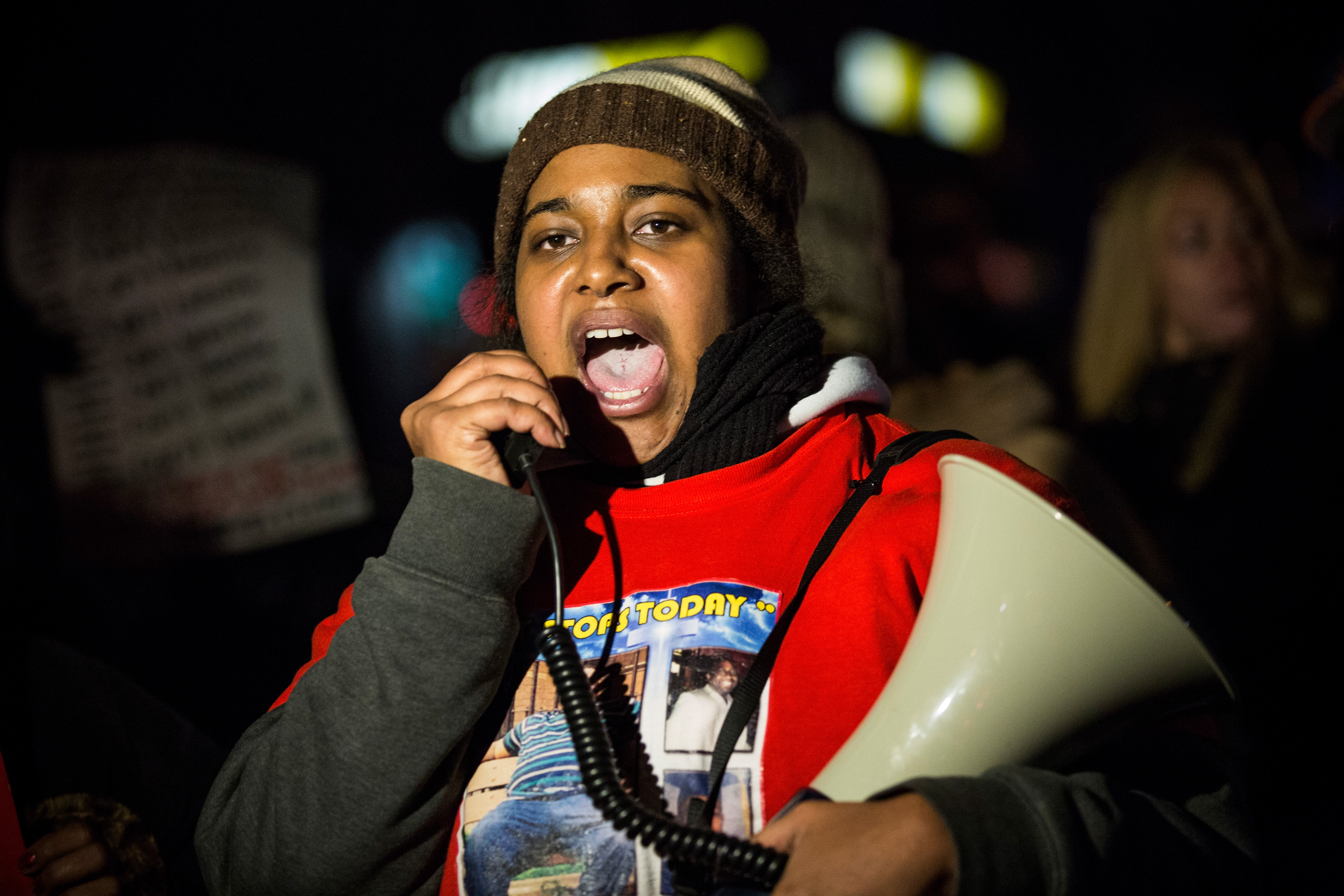 NEW YORK, NY - DEC 11, 2014:  Erica Garner, daughter of Eric Garner, leads a march of people protesting the Staten Island, New York grand jury's decision not to indict a police officer involved in the chokehold death of Eric Garner in July, on Dec. 11, 2014 in the Staten Island Neighborhood of New York City. (Photo by Andrew Burton/Getty Images)