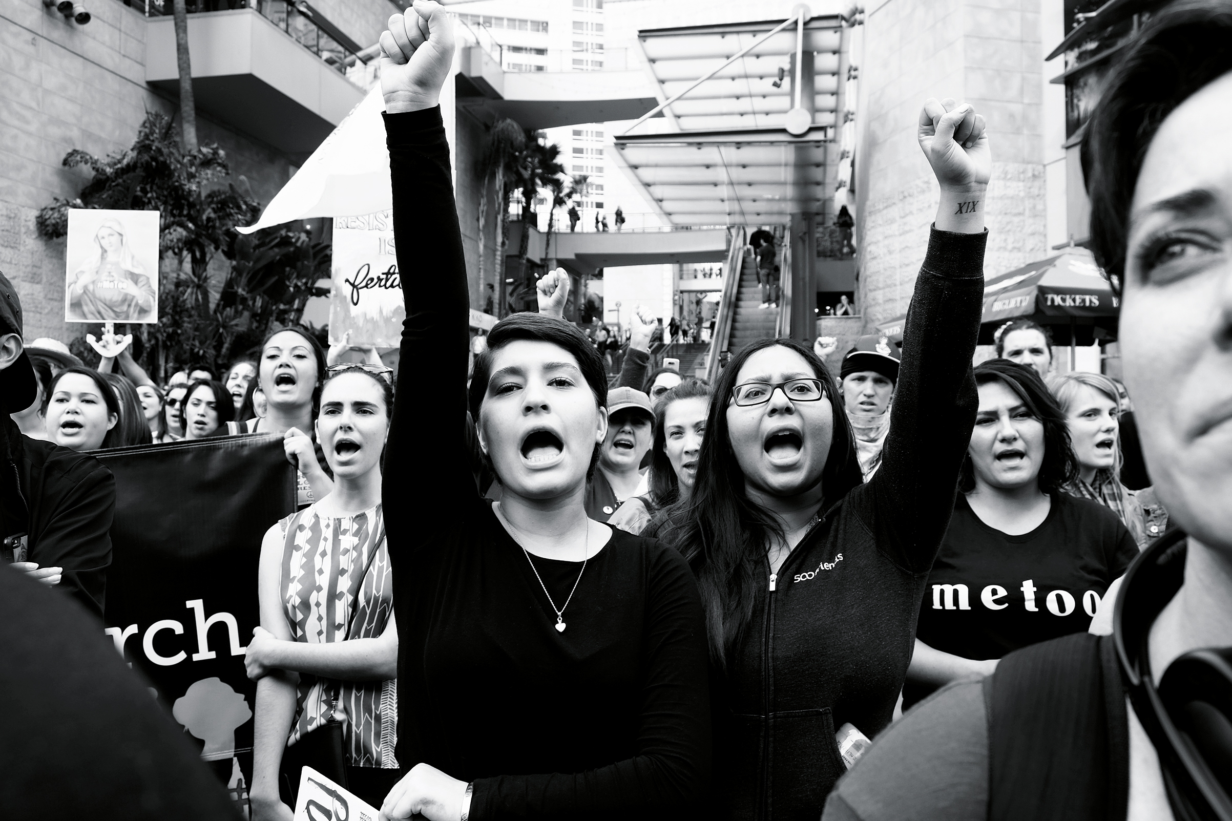 Women join together to pretest sexual harassment and assault at a rally in Hollywood, Nov. 2017.
