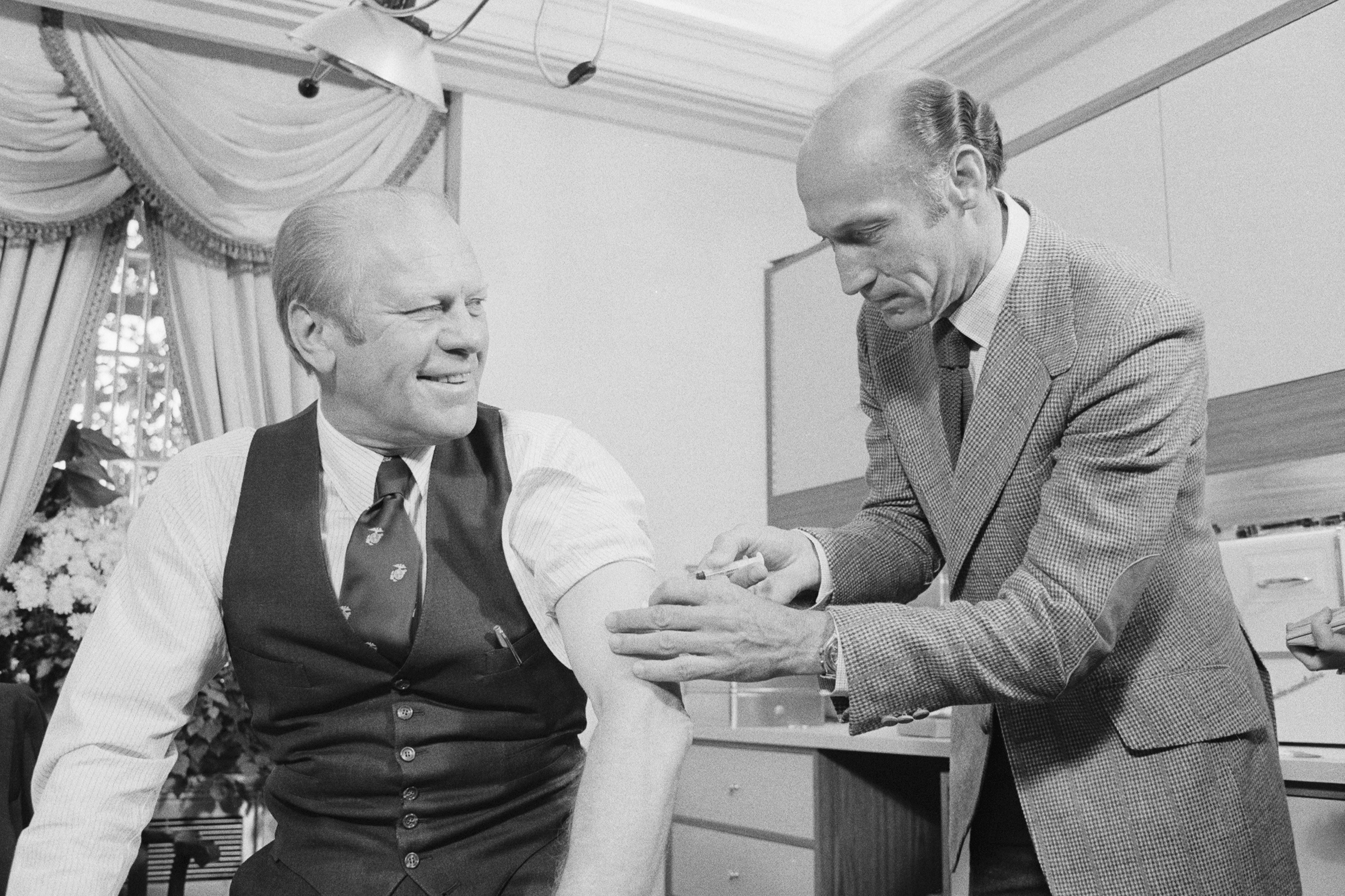 President Ford gets swine flu shot from Wm. Lukash on Oct. 14, 1976.