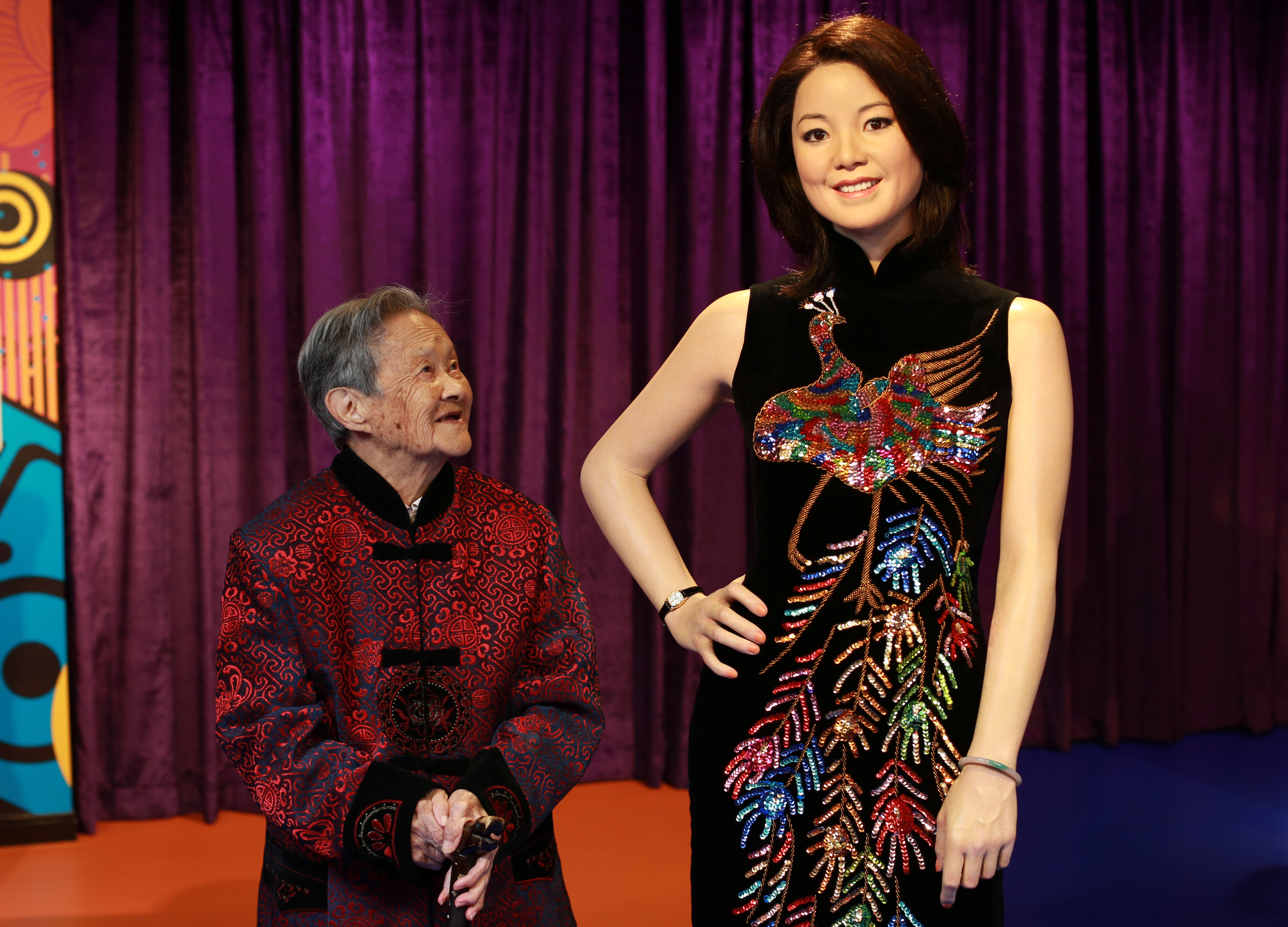 uang Xiaogui, 100 years old, poses with a wax figure of Teresa Teng at Madame Tussauds on in Wuhan, China on Oct. 11, 2013.