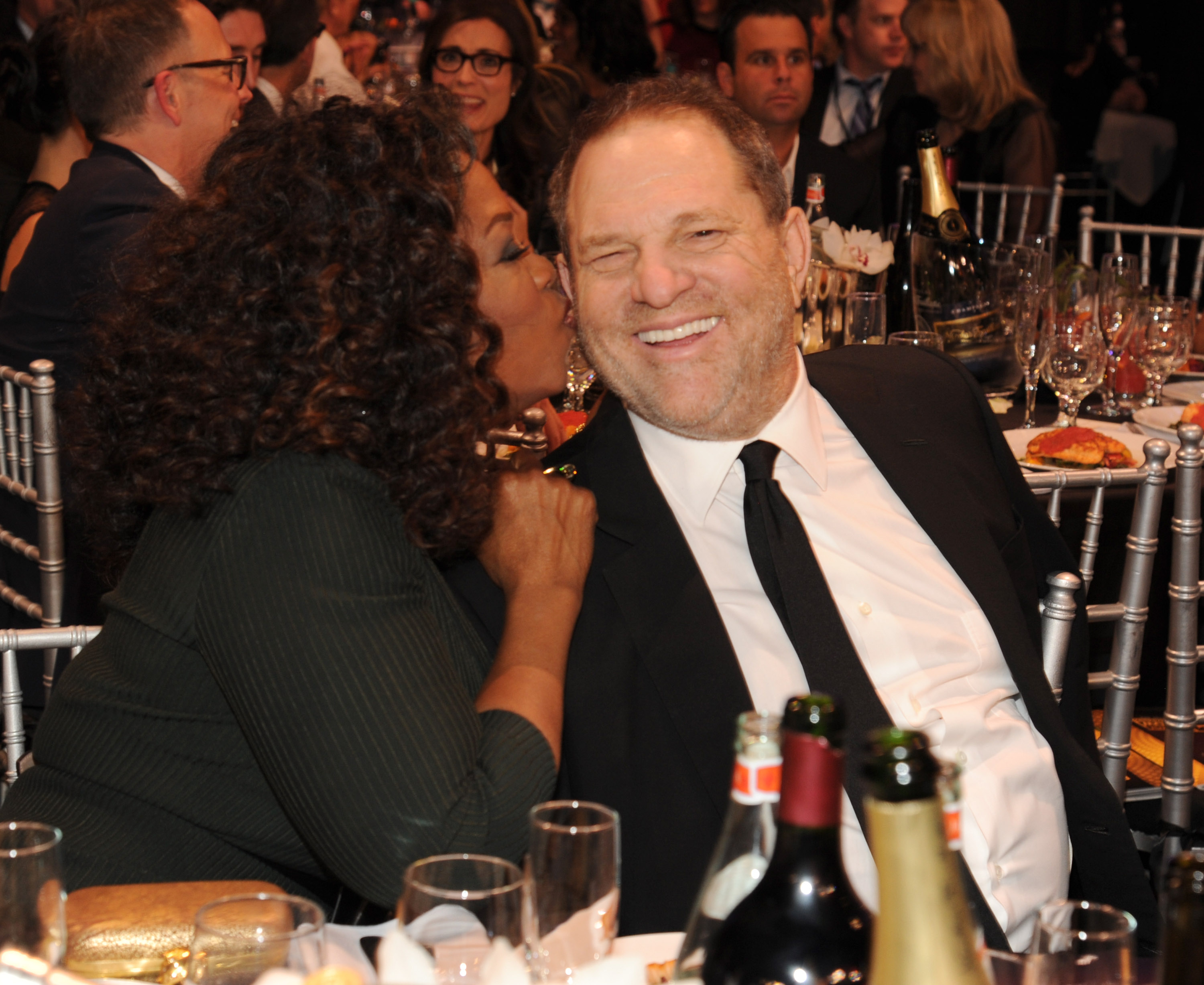 Oprah Winfrey and Harvey Weinstein attend the19th Annual Critics' Choice Movie Awards at Barker Hangar on January 16, 2014 in Santa Monica, California.