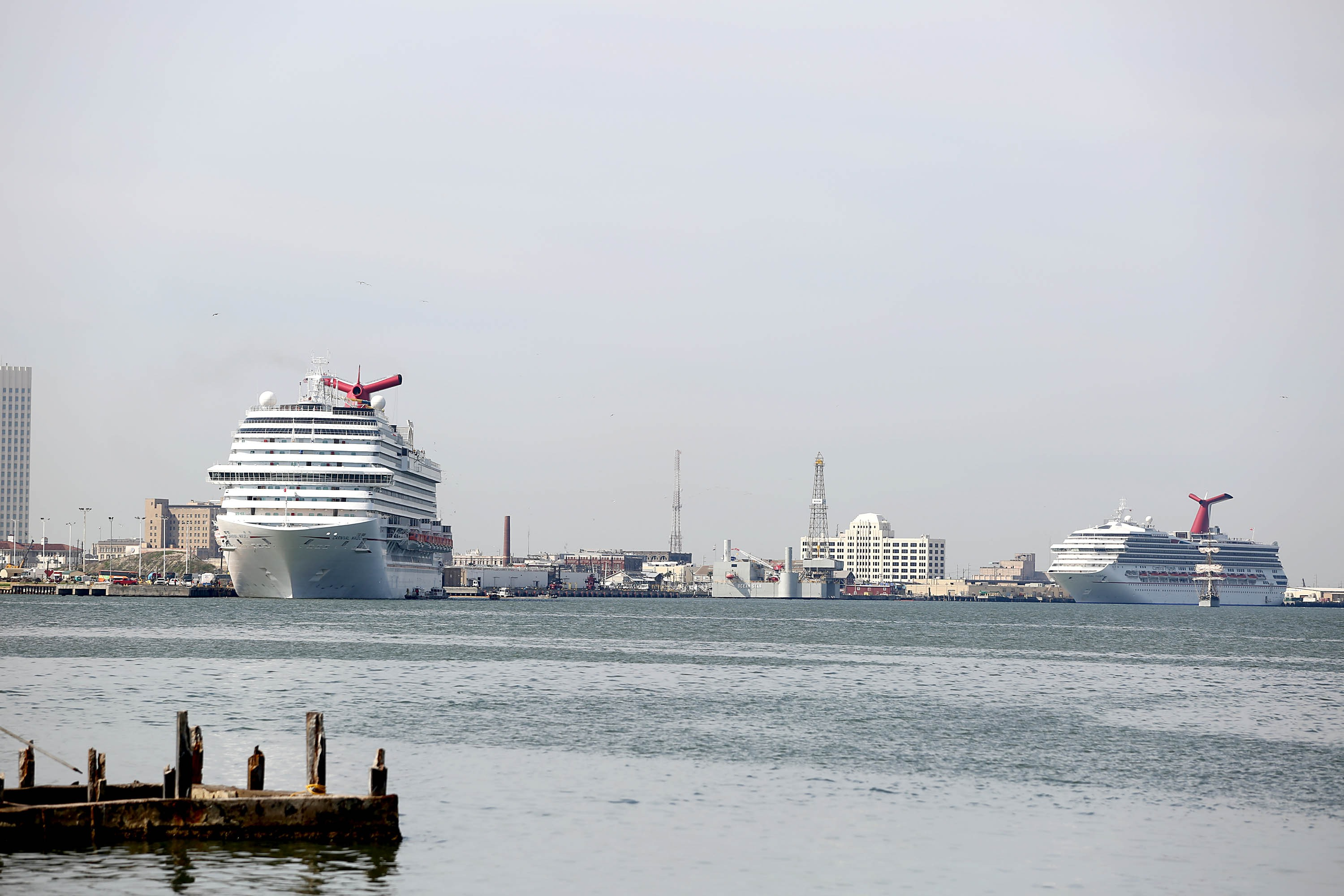 The Carnival Cruise Ship  Triumph  along with two other cruise ships sit in the Houston Port on March 25, 2014 in Galveston, Texas.