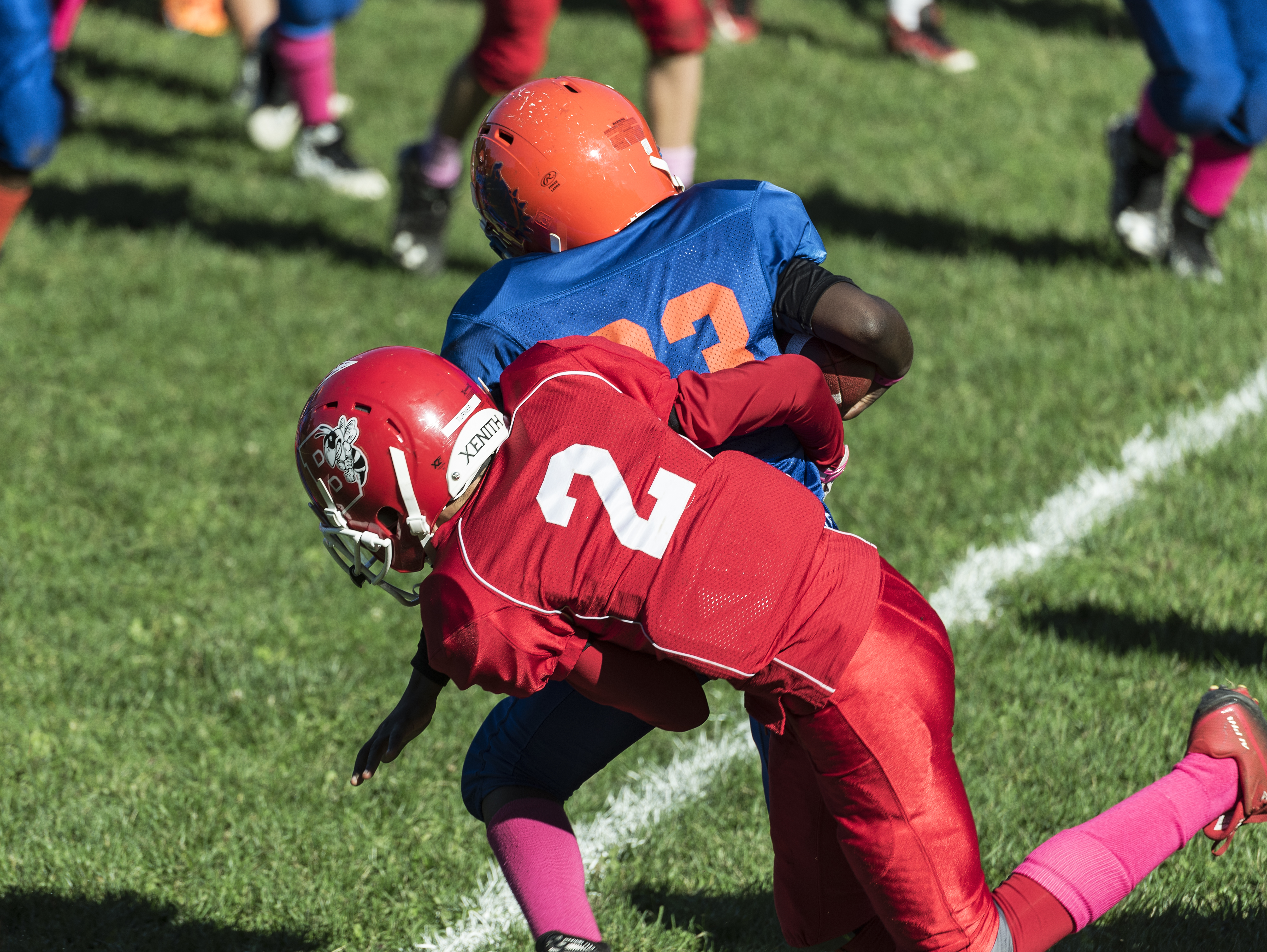 Making a tackle during a Pop Warner football game.