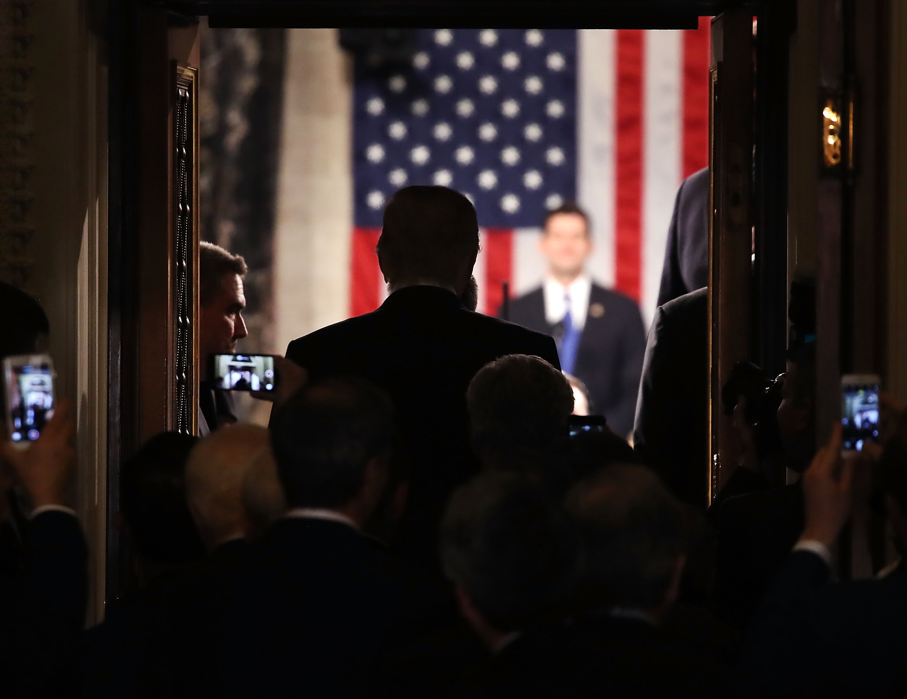 U.S. President Donald Trump stands in the doorway of the House chamber while being introduced to speak before a joint session of Congress on Feb. 28, 2017 in Washington, DC.
