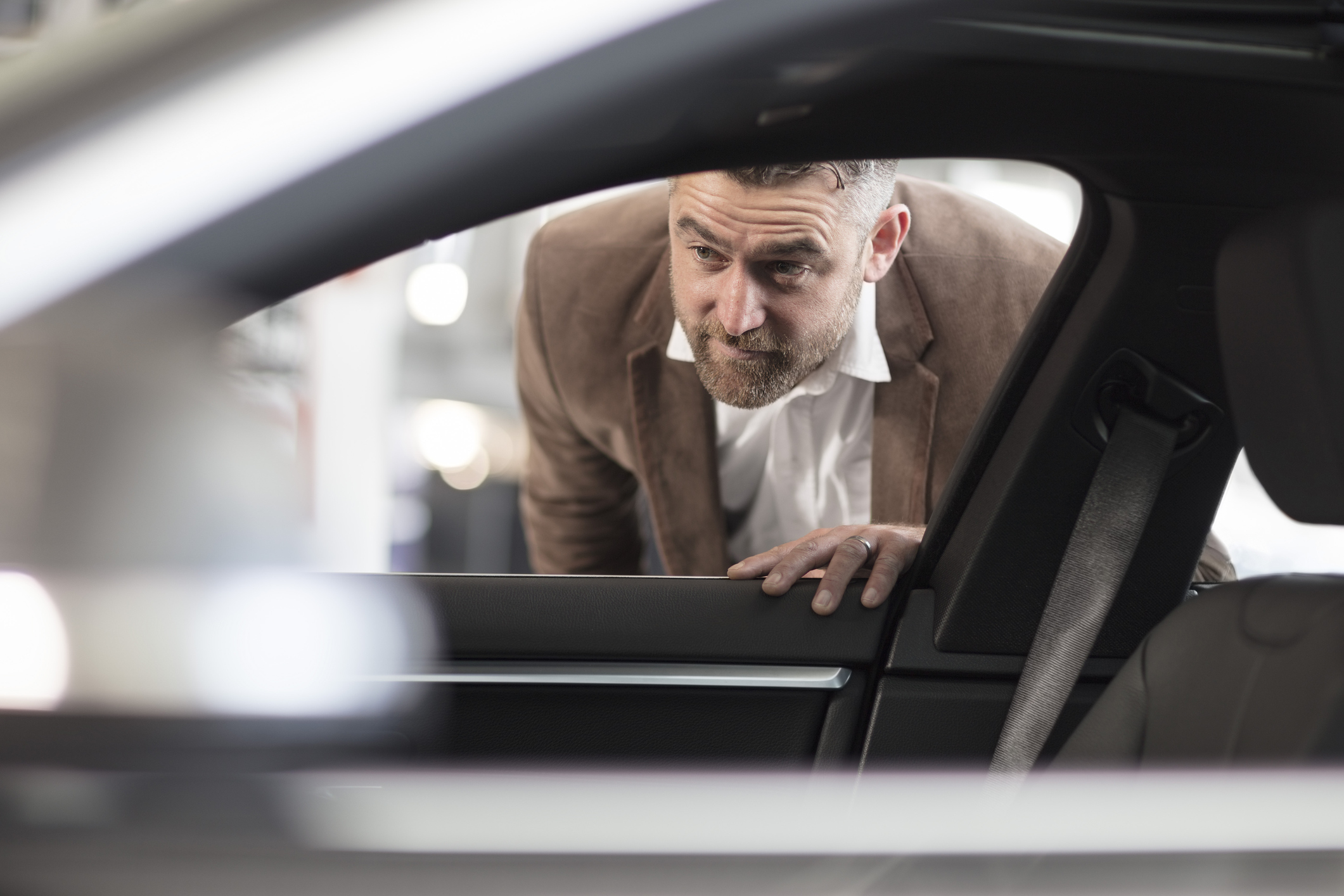 Cape Town, South Africa, man looking through car in car dealership