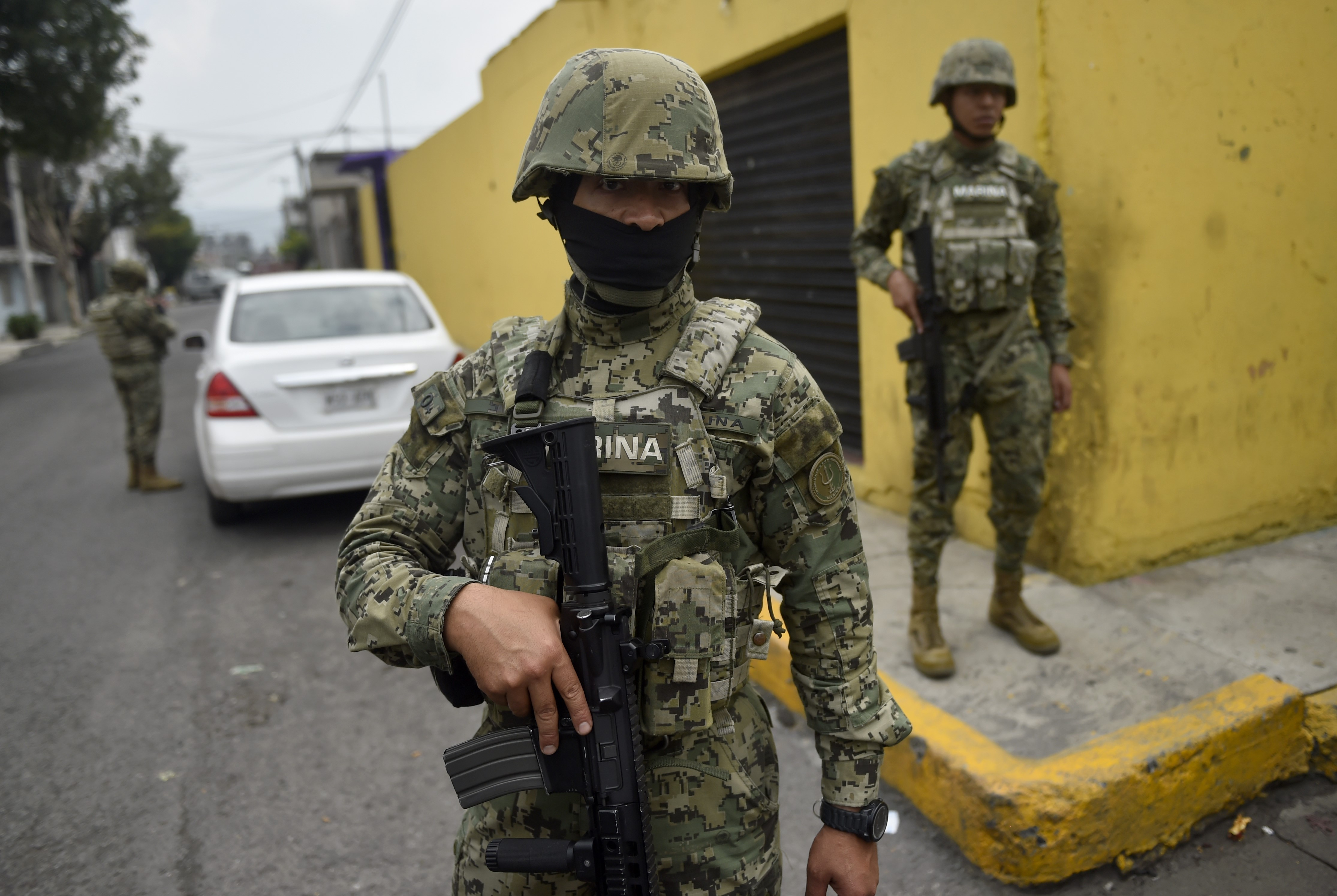 Mexican Navy members mount guard following a shoot-out in Tlahuac, Mexico City, on July 20, 2017.