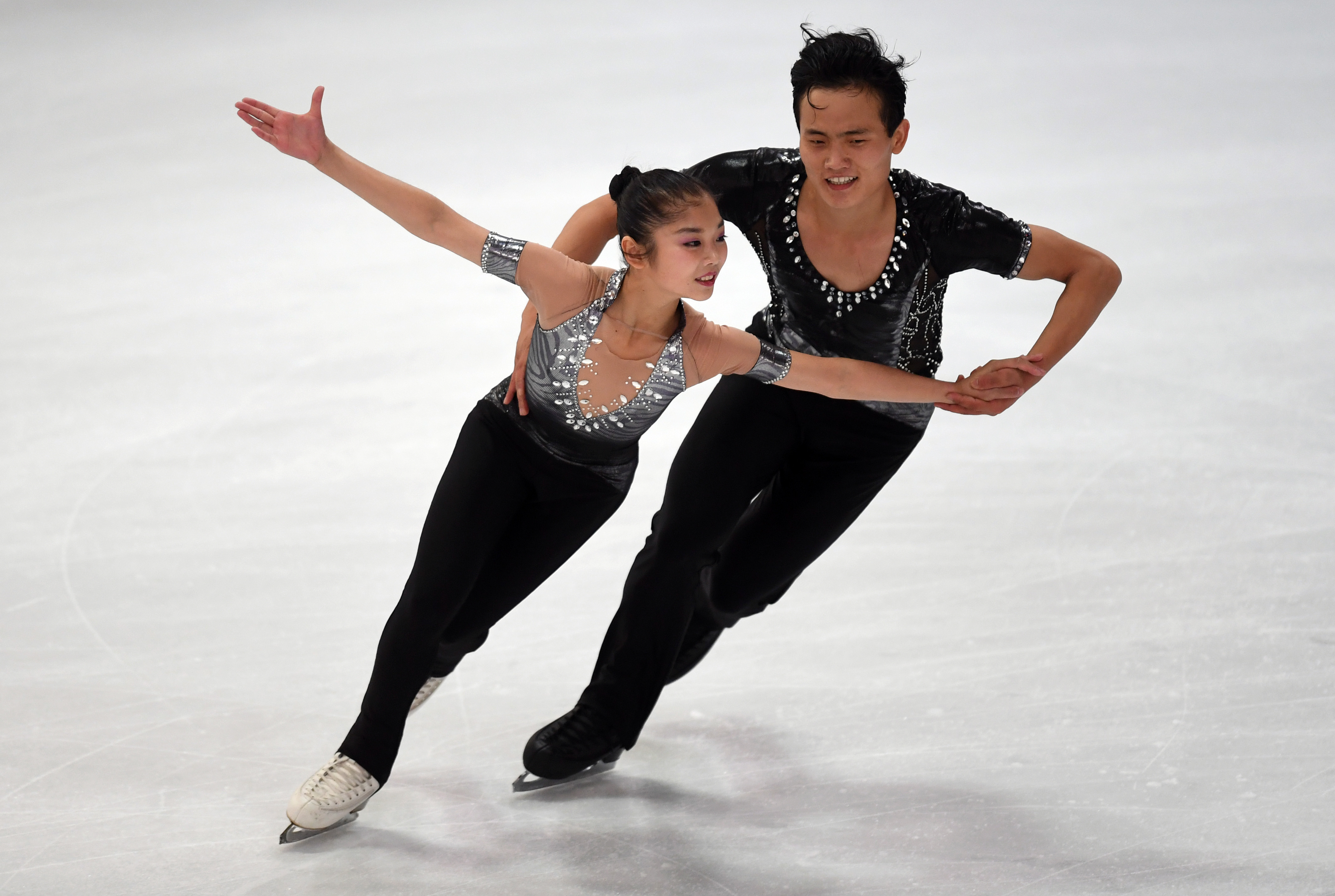 Ryom Tae-Ok and Kim Ju-Sik of North Korea perform during their pairs short program of the 49th Nebelhorn trophy figure skating competition in  Oberstdorf, southern Germany, on September 28, 2017. / AFP PHOTO / Christof STACHE        (Photo credit should read CHRISTOF STACHE/AFP/Getty Images)