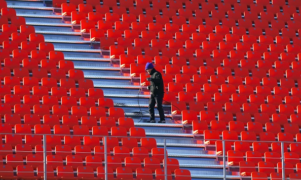 This picture taken on December 12, 2017 shows a South Korean worker setting up a cable at the Olympic Stadium, the venue of the opening and closing ceremony for the PyeongChang 2018 Winter Olympic Games, in Pyeongchang.