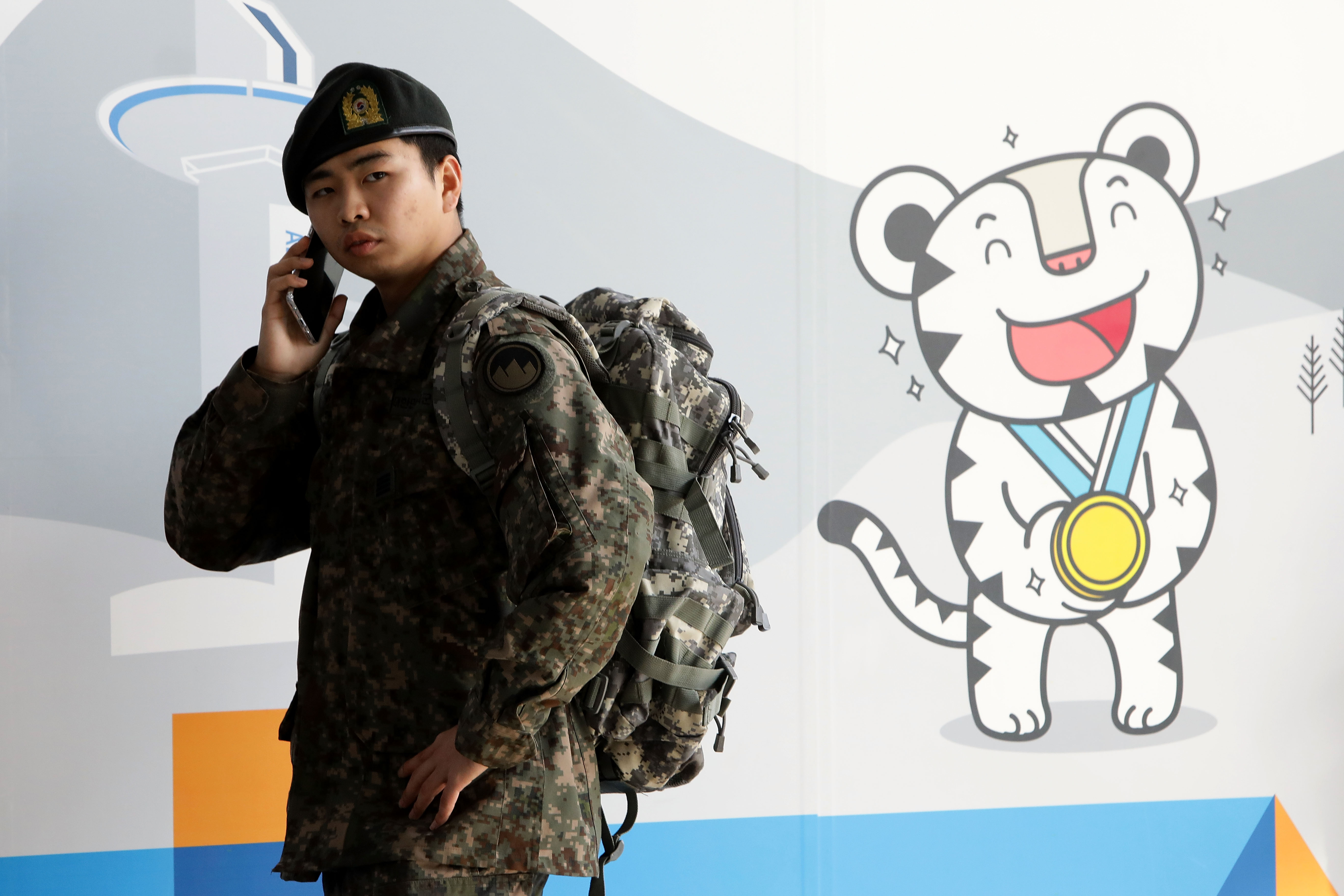 A South Korean soldier at a 2018 PyeongChang Winter Olympics booth in Seoul, South Korea on Jan. 5, 2018