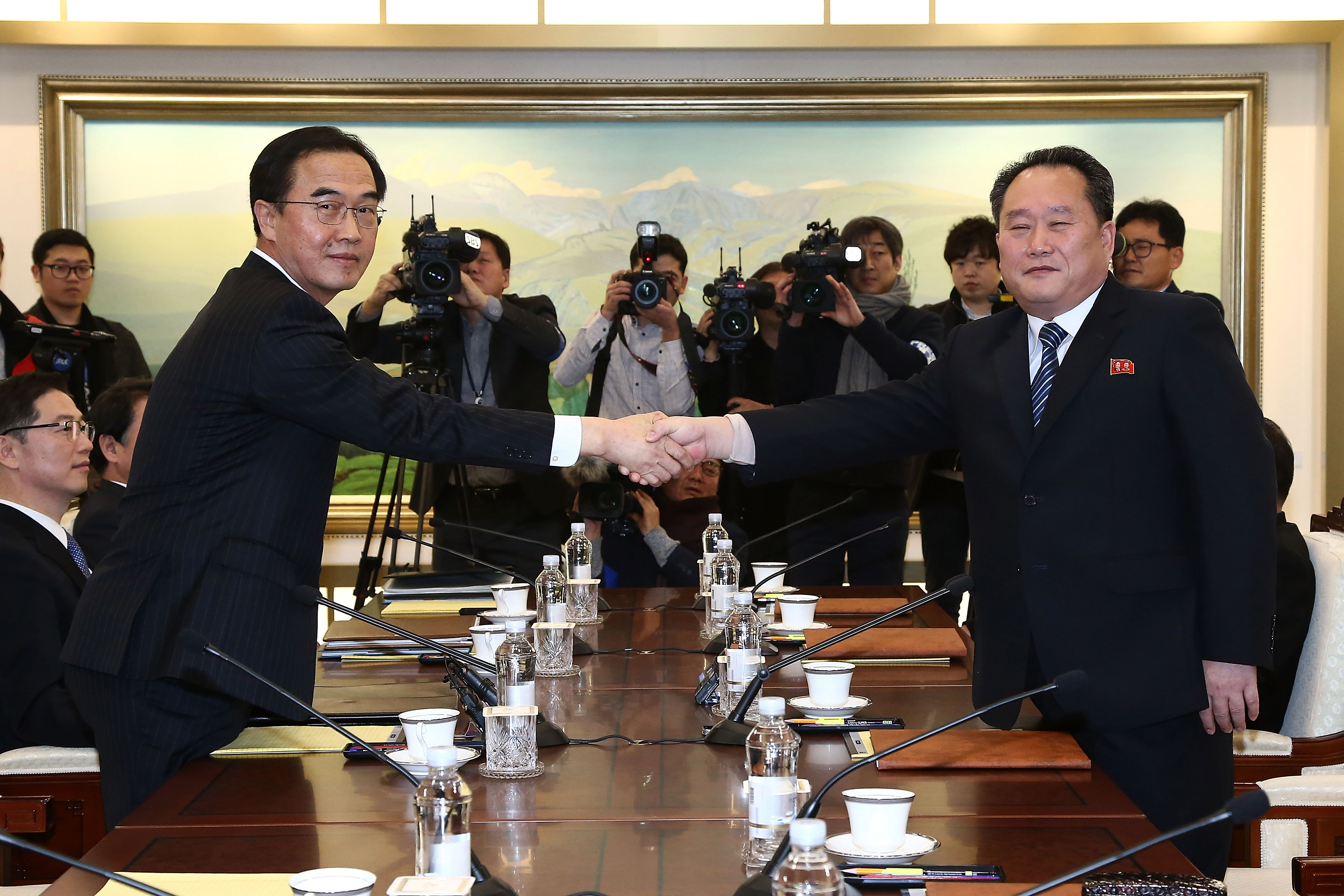 South Korean Unification Minister Cho Myoung-gyon shakes hands with the head of North Korean delegation Ri Son-Gwon before their meeting at the Panmunjom in the DMZ on Jan. 9, 2018.