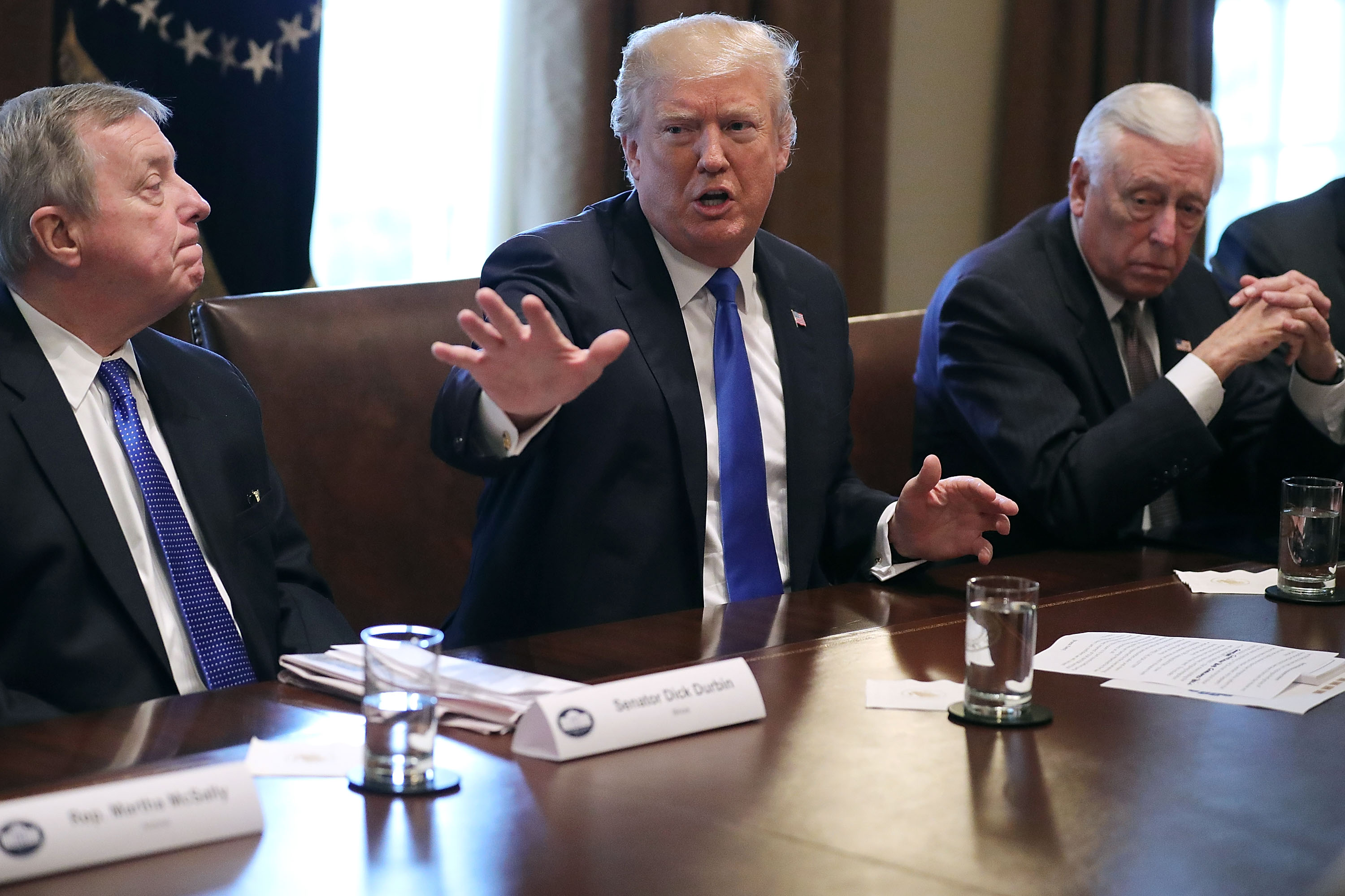 U.S. President Donald Trump (C) presides over a meeting about immigration with Republican and Democrat members of Congress, including Senate Minority Whip Richard Durbin (D-IL) (L) and House Minority Whip Steny Hoyer (D-MD) in the Cabinet Room at the White House January 9, 2018 in Washington, DC.