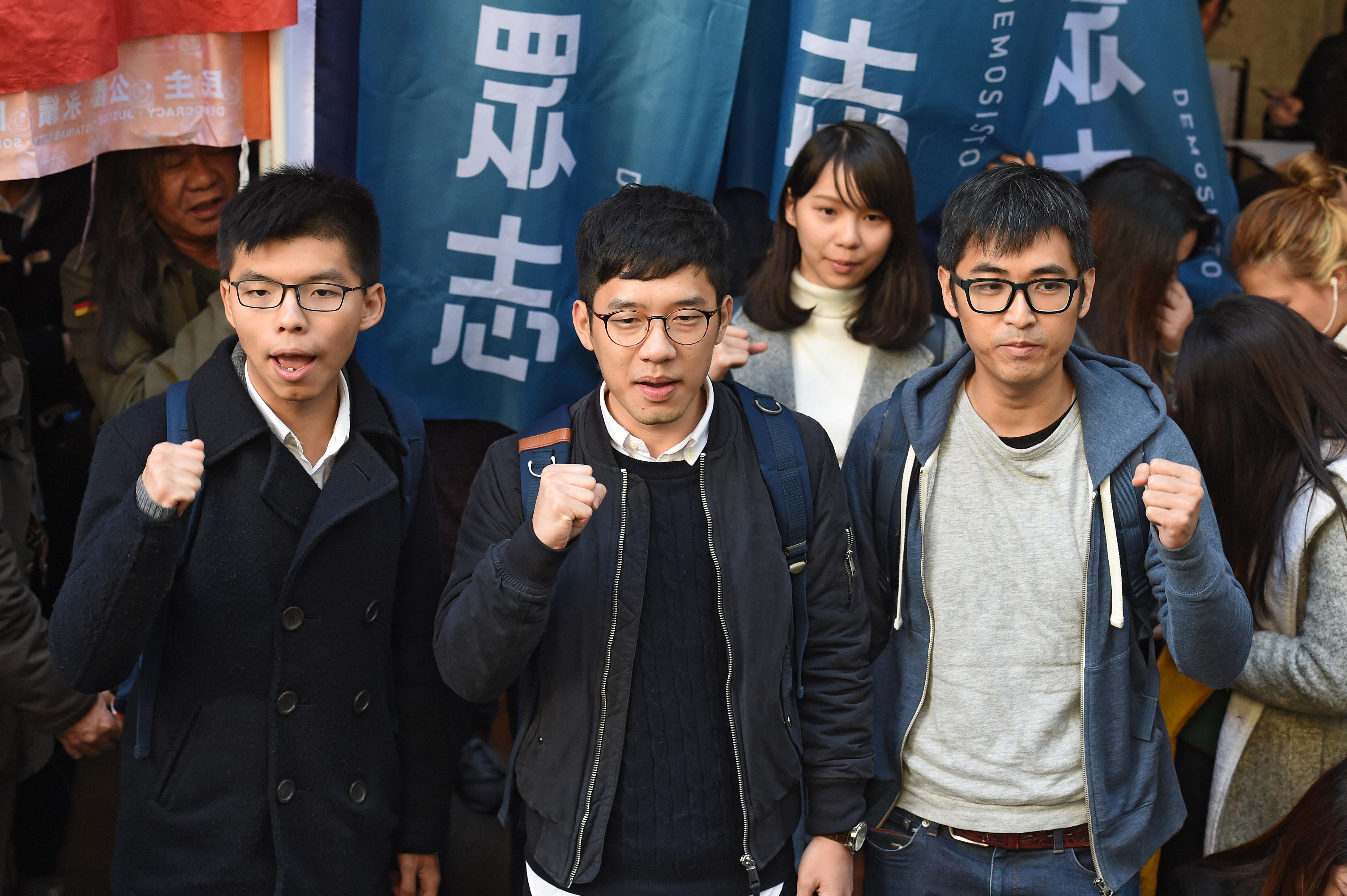 Hong Kong democracy activists Joshua Wong, Nathan Law and Alex Chow outside Hong Kong's Court of Final Appeal before a hearing on Jan. 16, 2018.