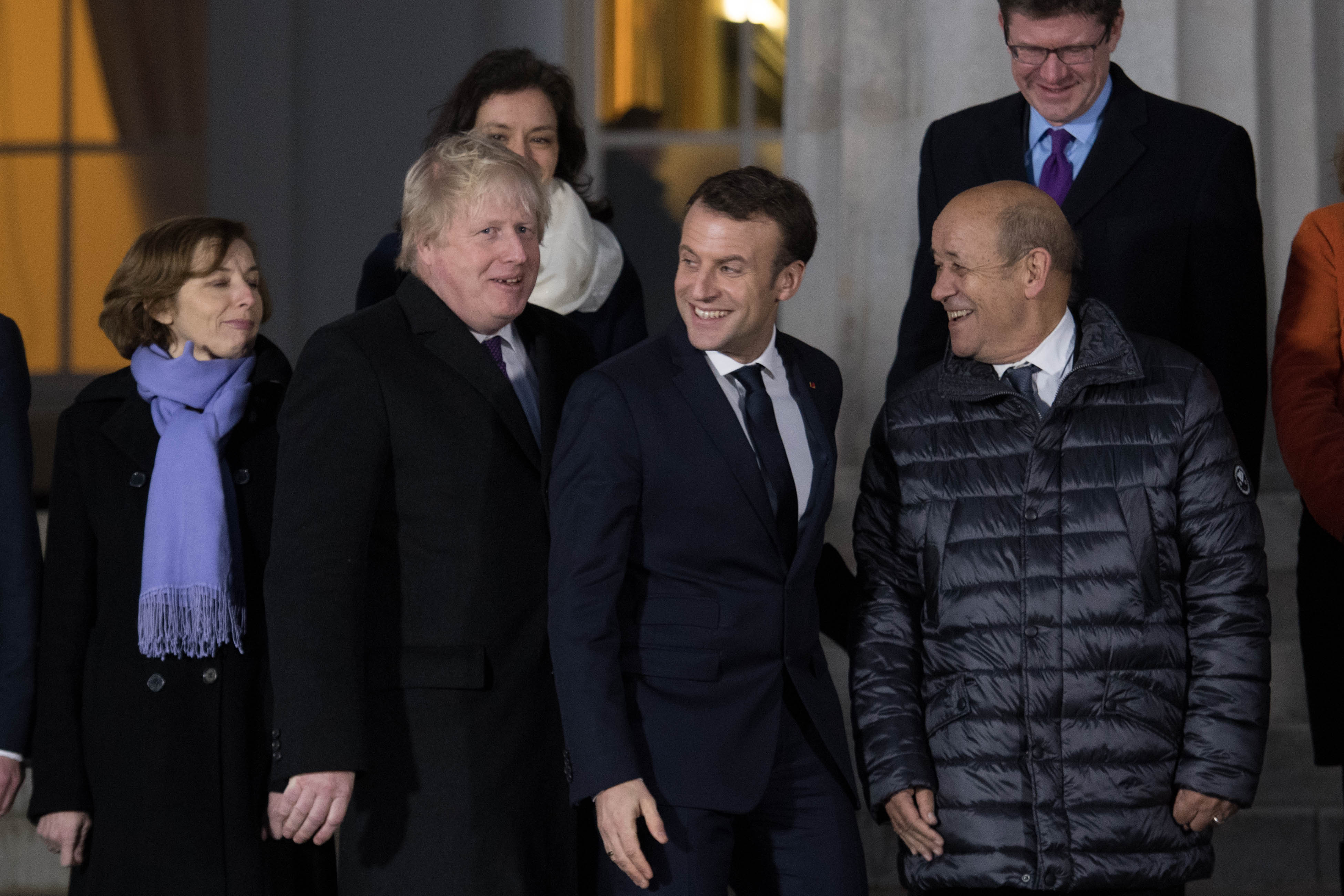 CAMBERLEY, ENGLAND - JANUARY 18:  Foreign Secretary Boris Johnson (left) and French President Emmanuel Macron (centre) attend a 'family photograph' at the Royal Military Academy Sandhurst on January 18, 2018 in Camberley, England. The heads of MI5, MI6, GCHQ and France's DGSE and DGSI will meet to discuss how the UK and its allies across the Channel can work to counter threats such as the targeting of concert venues like Manchester Arena and the Bataclan in Paris. (Photo by Stefan Rousseau - WPA Pool / Getty Images)