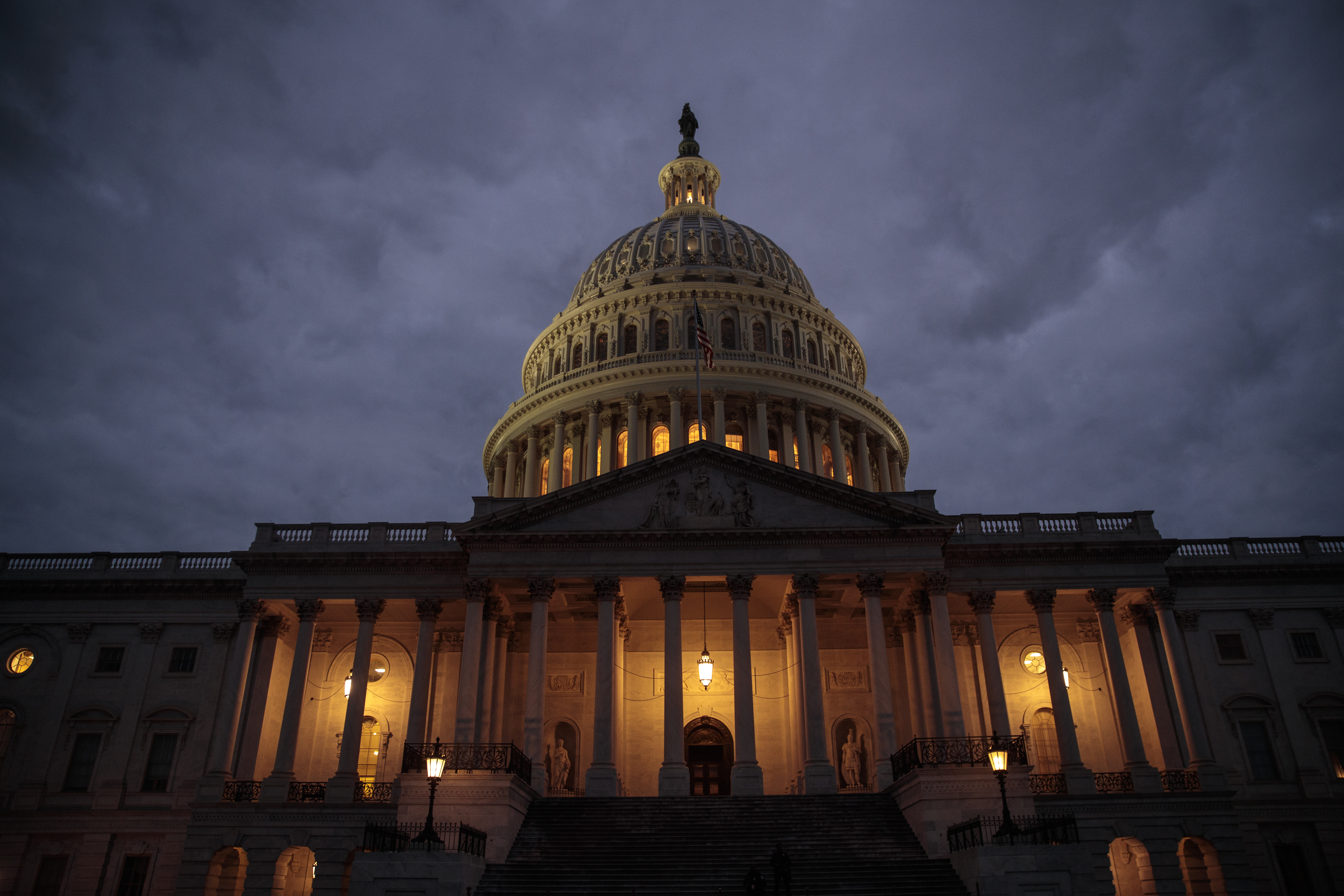 WASHINGTON, DC - JANUARY 21:  The U.S. Capitol is seen at dusk, January 21, 2018 in Washington, DC. Lawmakers are convening for a Sunday session to try to resolve the government shutdown. (Photo by Drew Angerer/Getty Images)