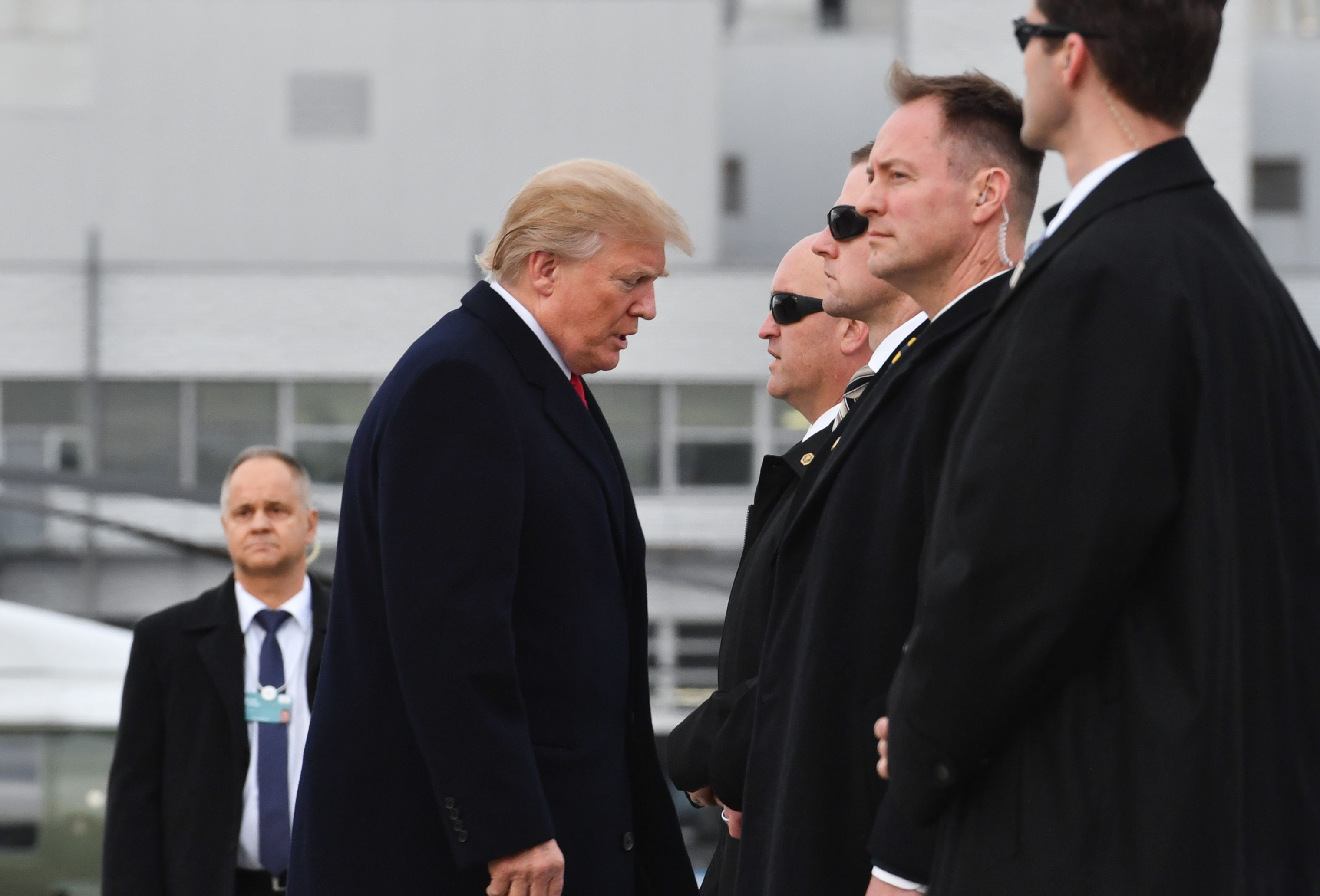 US President Donald Trump arrives before boarding the Air Force One ahead of his departure from Zurich Airport in Zurich on January 26, 2018.
