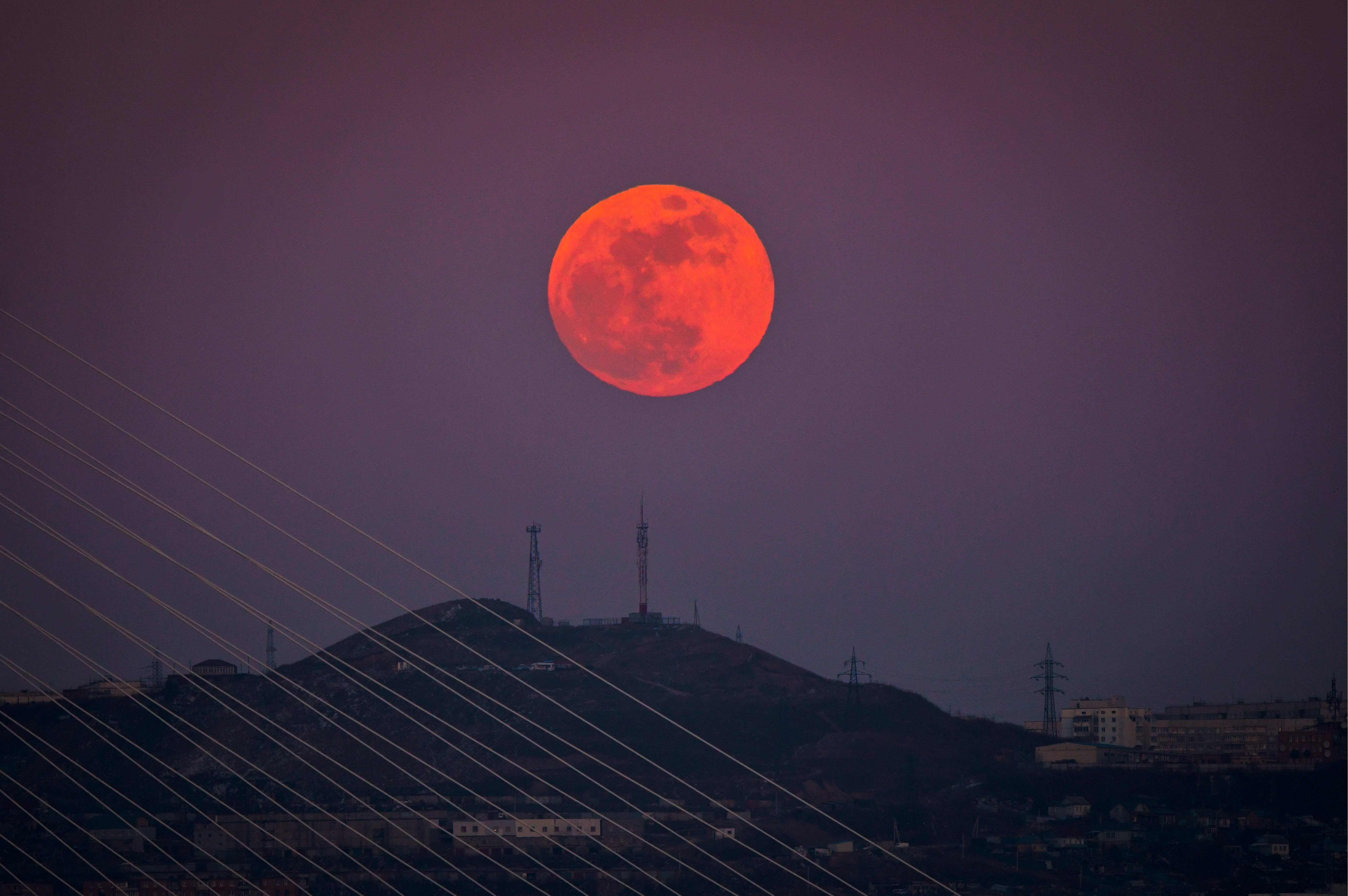 A red supermoon rises over hills in the city of Vladivostok in Russia's Far East on January 31, 2018.
