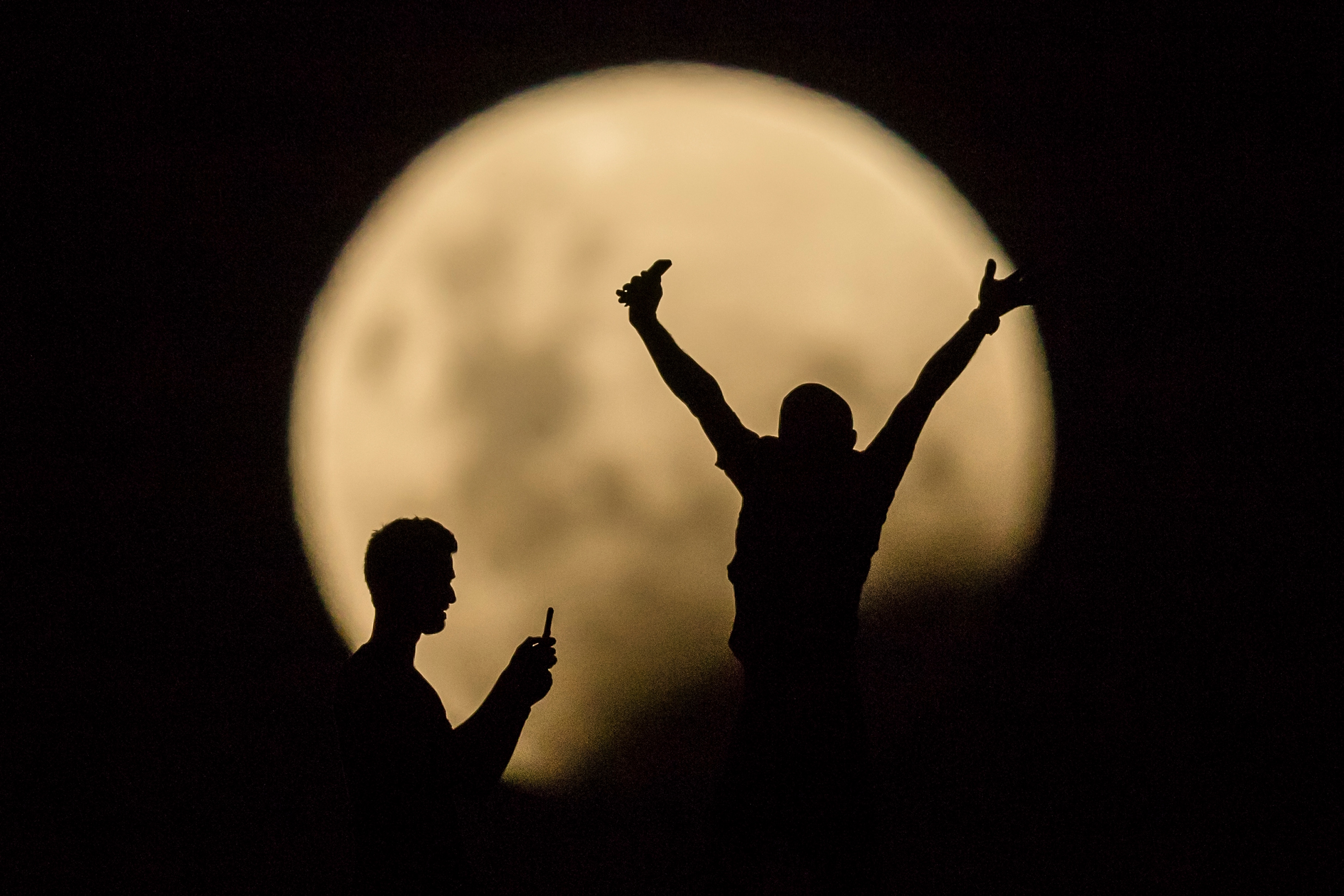 People take photos of the Super moon in Lancelin, Australia, on Jan. 31, 2018.