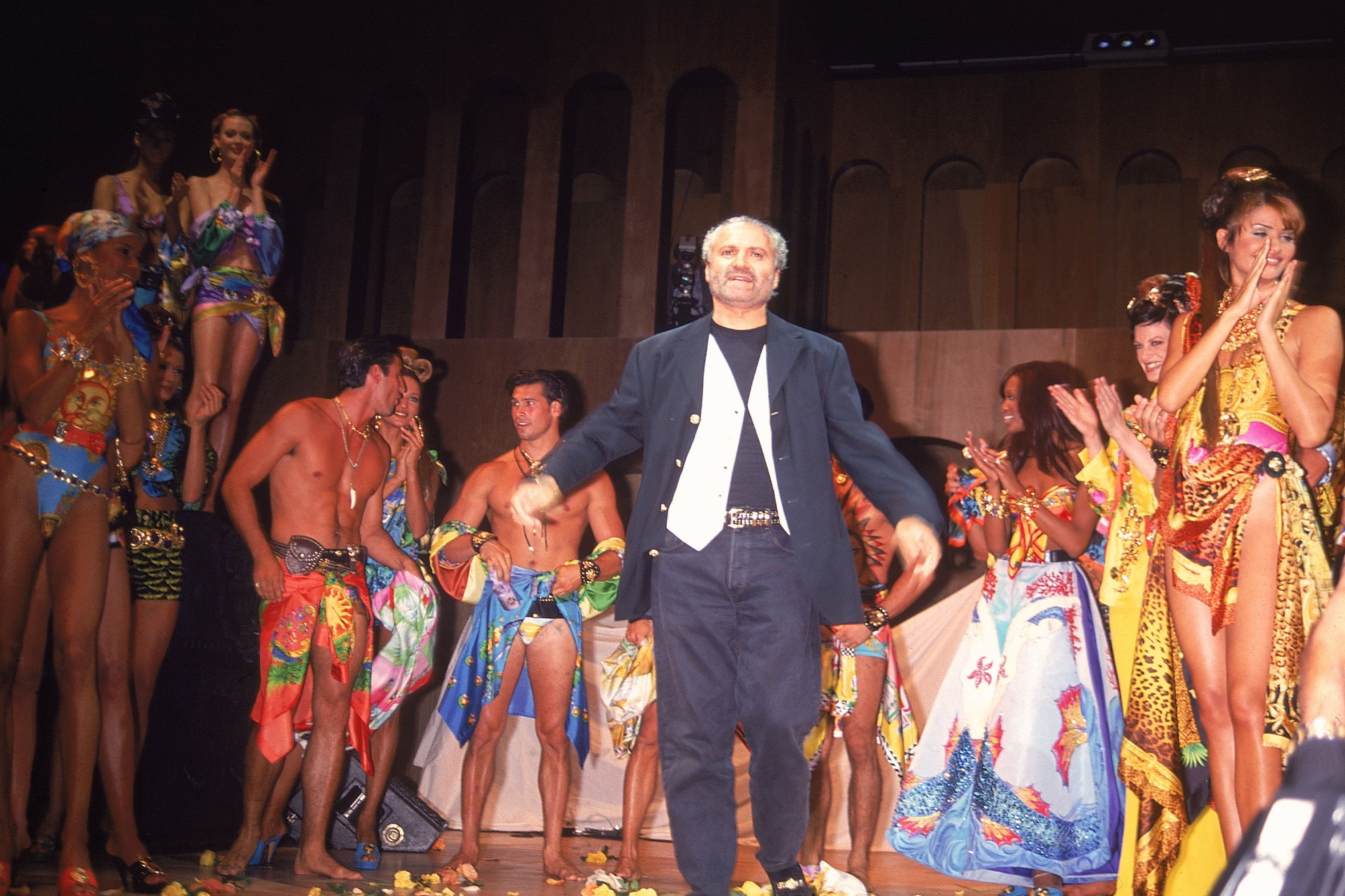 Designer Gianni Versace appearing at a fashion show.