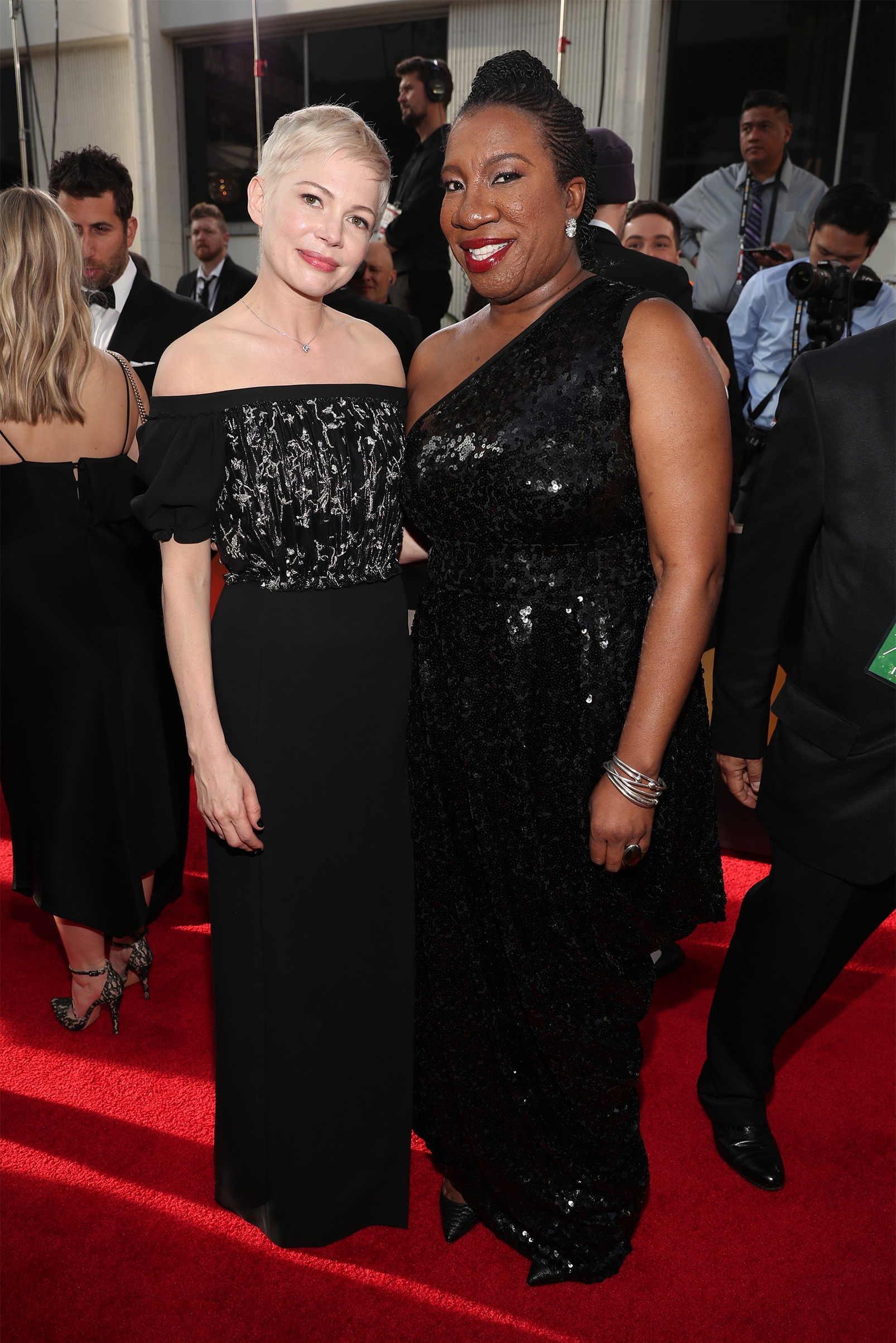 Actor Michelle Williams and activist Tarana Burke arrive to the 75th Annual Golden Globe Awards held at the Beverly Hilton Hotel on January 7, 2018.