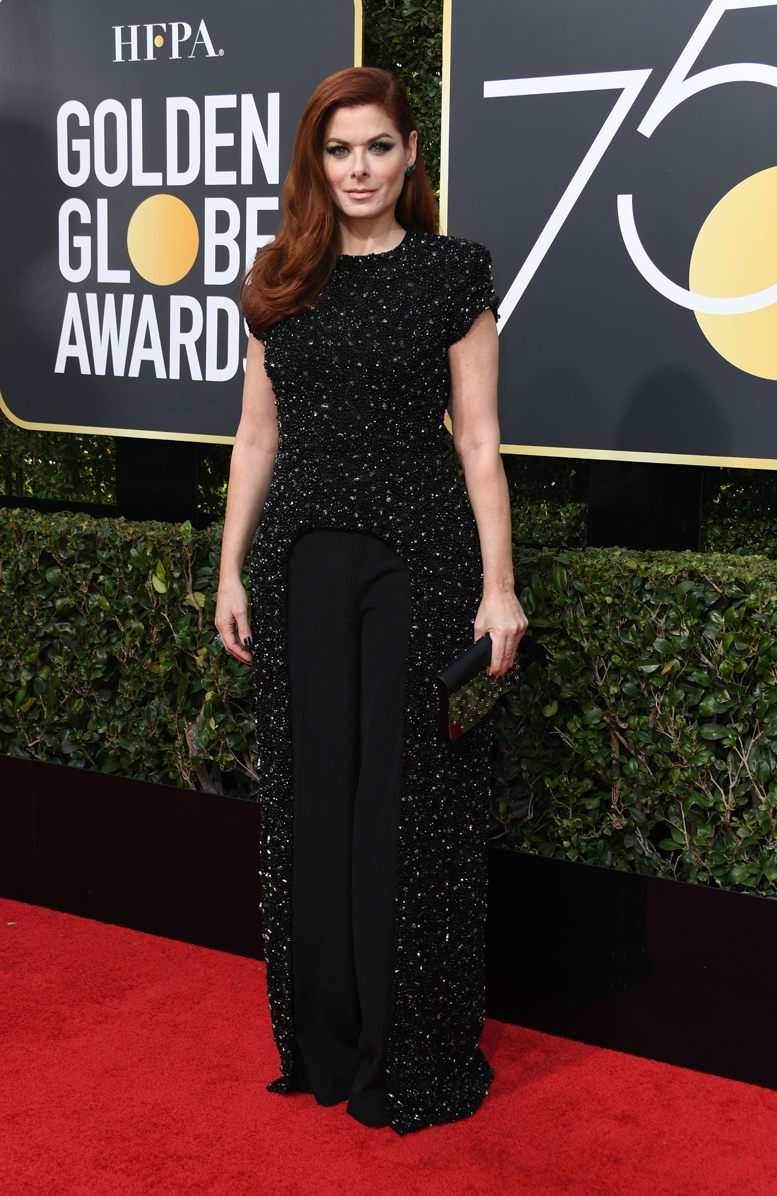 Actress Debra Messing arrives for the 75th Golden Globe Awards on January 7, 2018, in Beverly Hills, California.