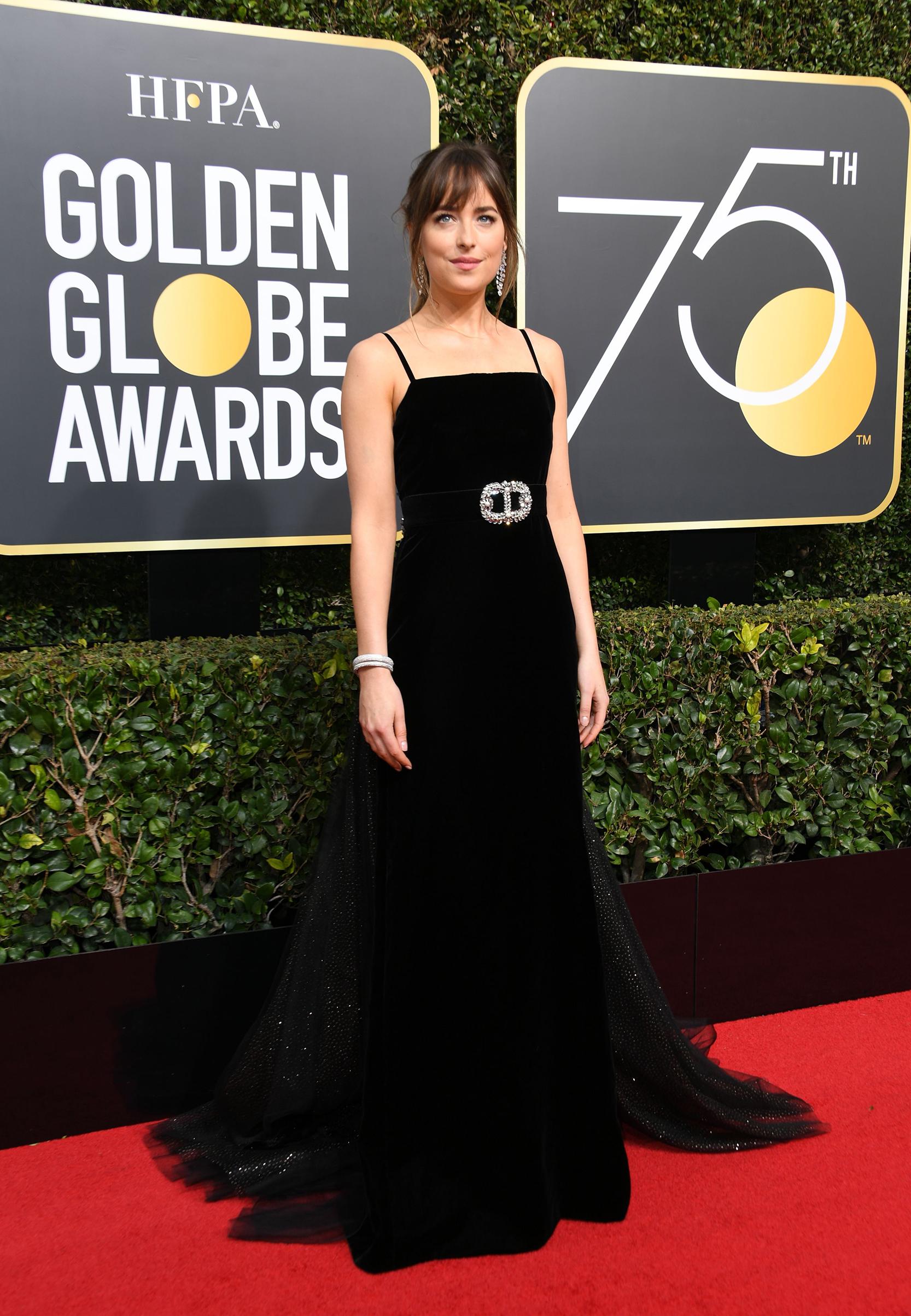 Actress Dakota Johnson arrives for the 75th Golden Globe Awards on January 7, 2018, in Beverly Hills, California.