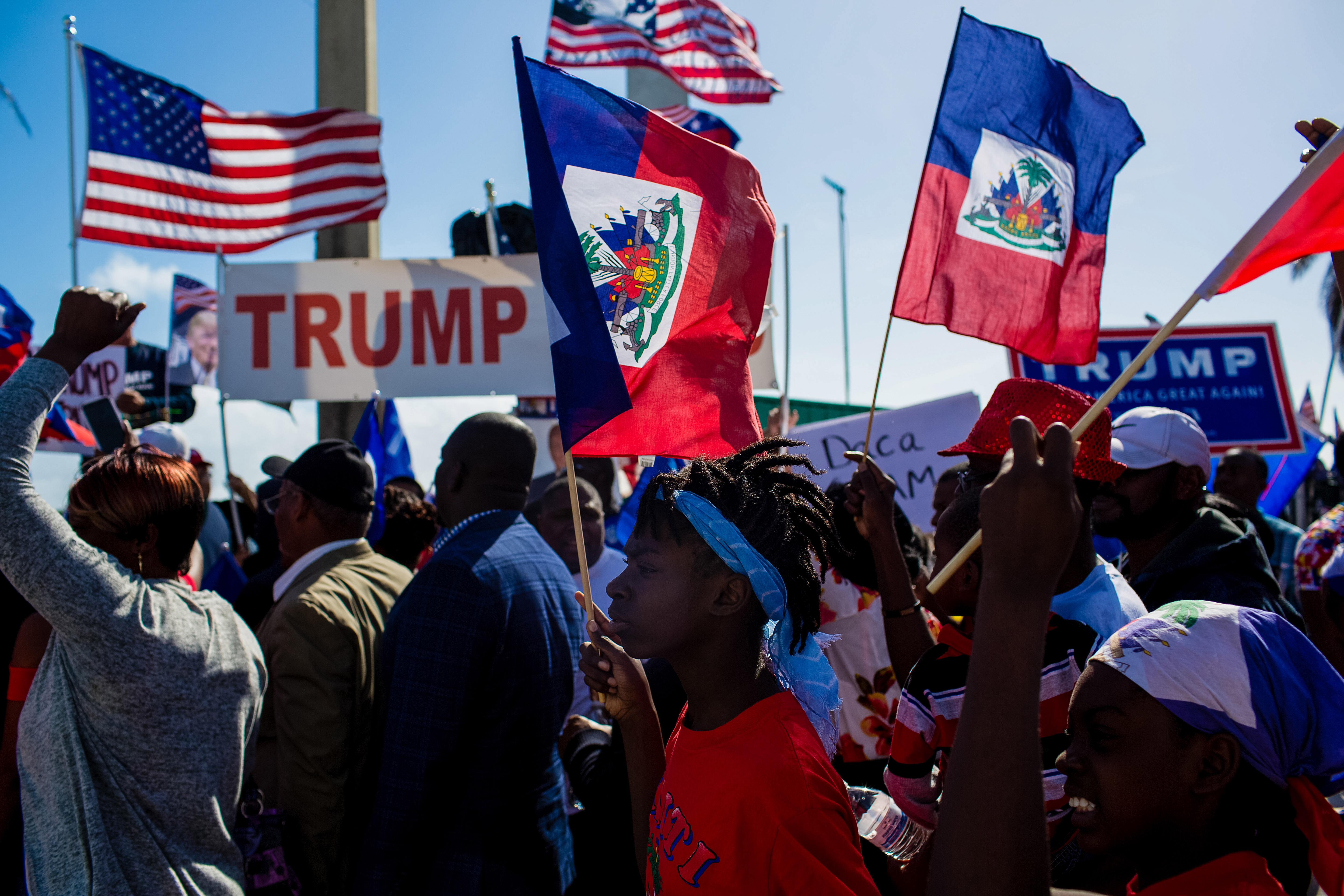 Demonstrators hold Haitian and American flags during a protest against U.S. President Donald Trump.