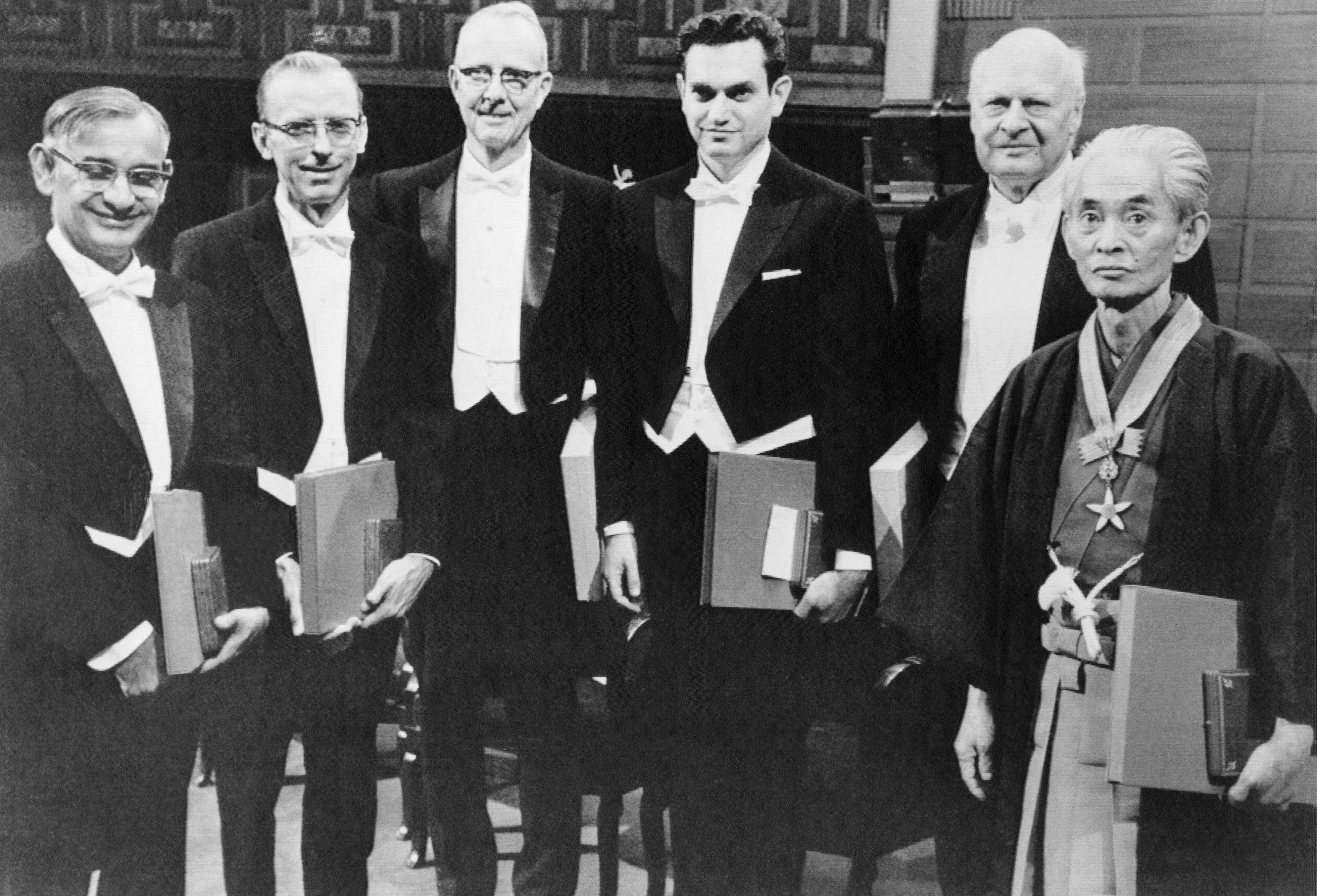 (Original Caption) Nobel Prize Winners. Stockholm: The 1968 Nobel Prize recipients, five Americans and one Japanese where judged to have  most benefited mankind  in the past year. They appear here at the awards ceremony. Left to right: Professor H. Gobind Khorana, Robert W. Holley, Professor Luis W. Alvarez, Dr. Marshall W. Nirenberg, Lars Onsager and Japanese author Yasunari Kawabata.