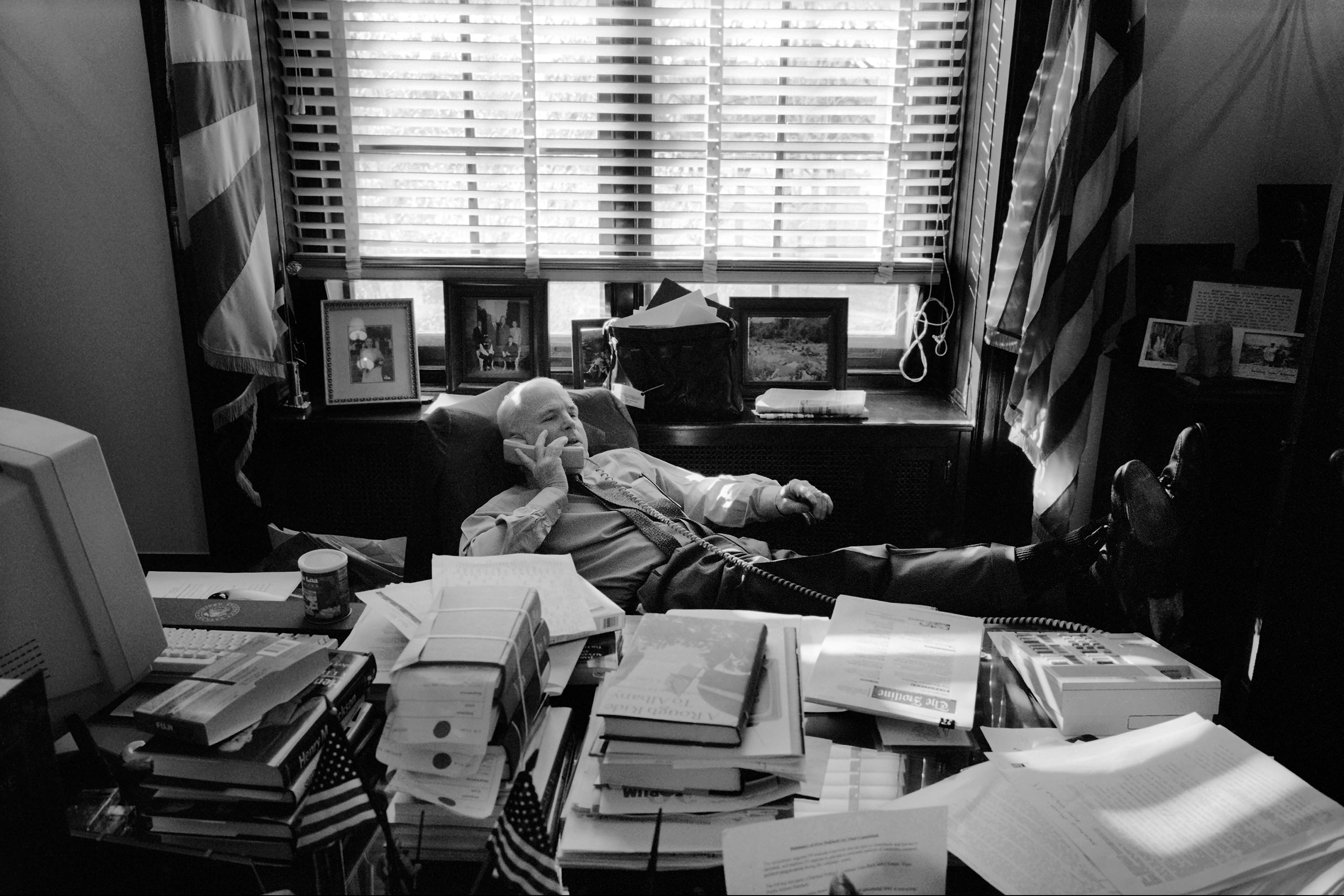 Sen. John McCain working in his Capitol Hill office after the first week of battle in the Senate debate on his proposed campaign finance reform bill.