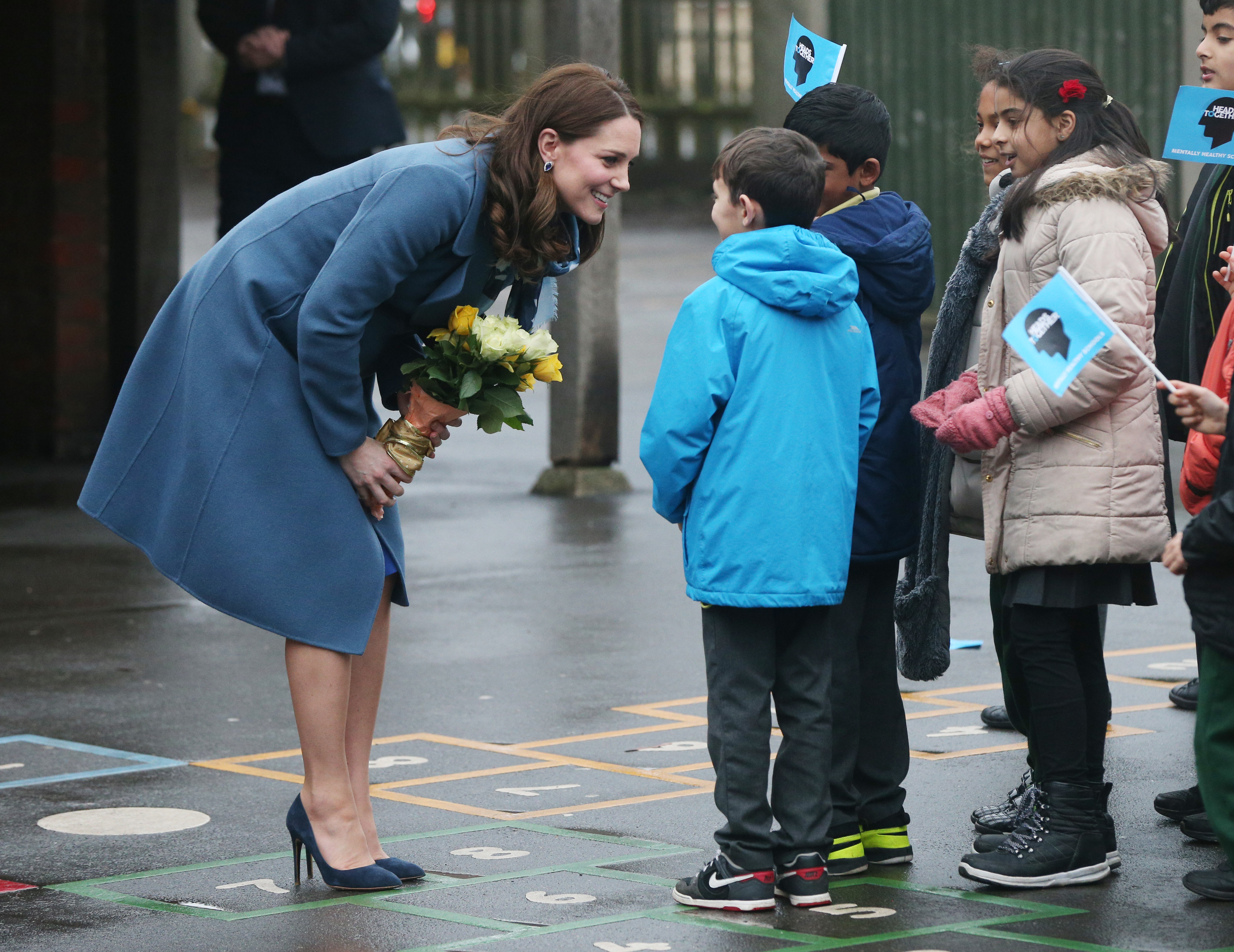 Kate Middleton, Duchess of Cambridge, meets with children and teachers as she launches a mental health program for schools—the latest initiative from the Heads Together campaign—during her visit to Roe Green Junior School on Jan. 23, 2018 in London