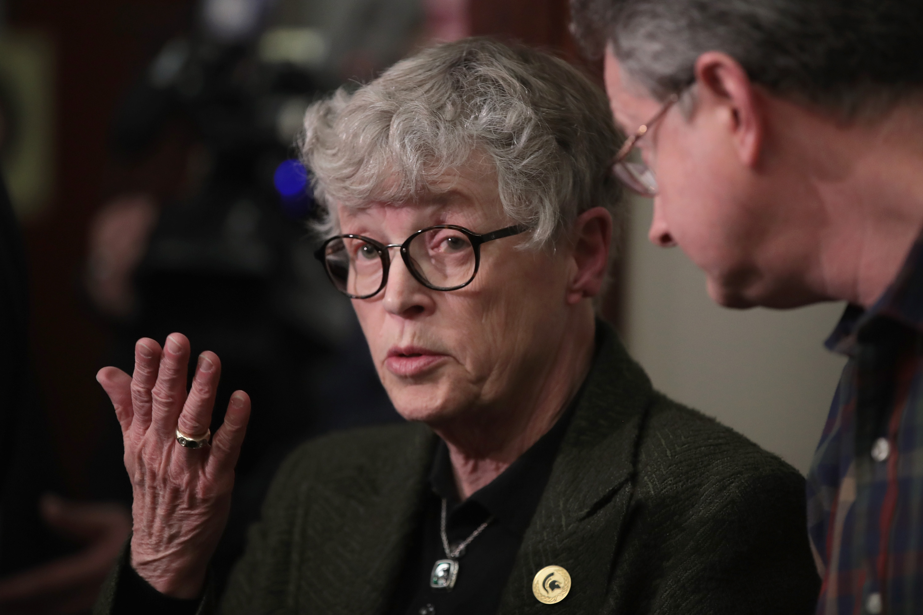 Michigan State University (MSU) President Lou Anna Simon answers a question after being confronted by former MSU gymnast Lidsey Lemke during a break in the sentencing hearing for Larry Nassar, who has been accused of molesting more than 100 girls while he was a physician for USA Gymnastics and Michigan State University.