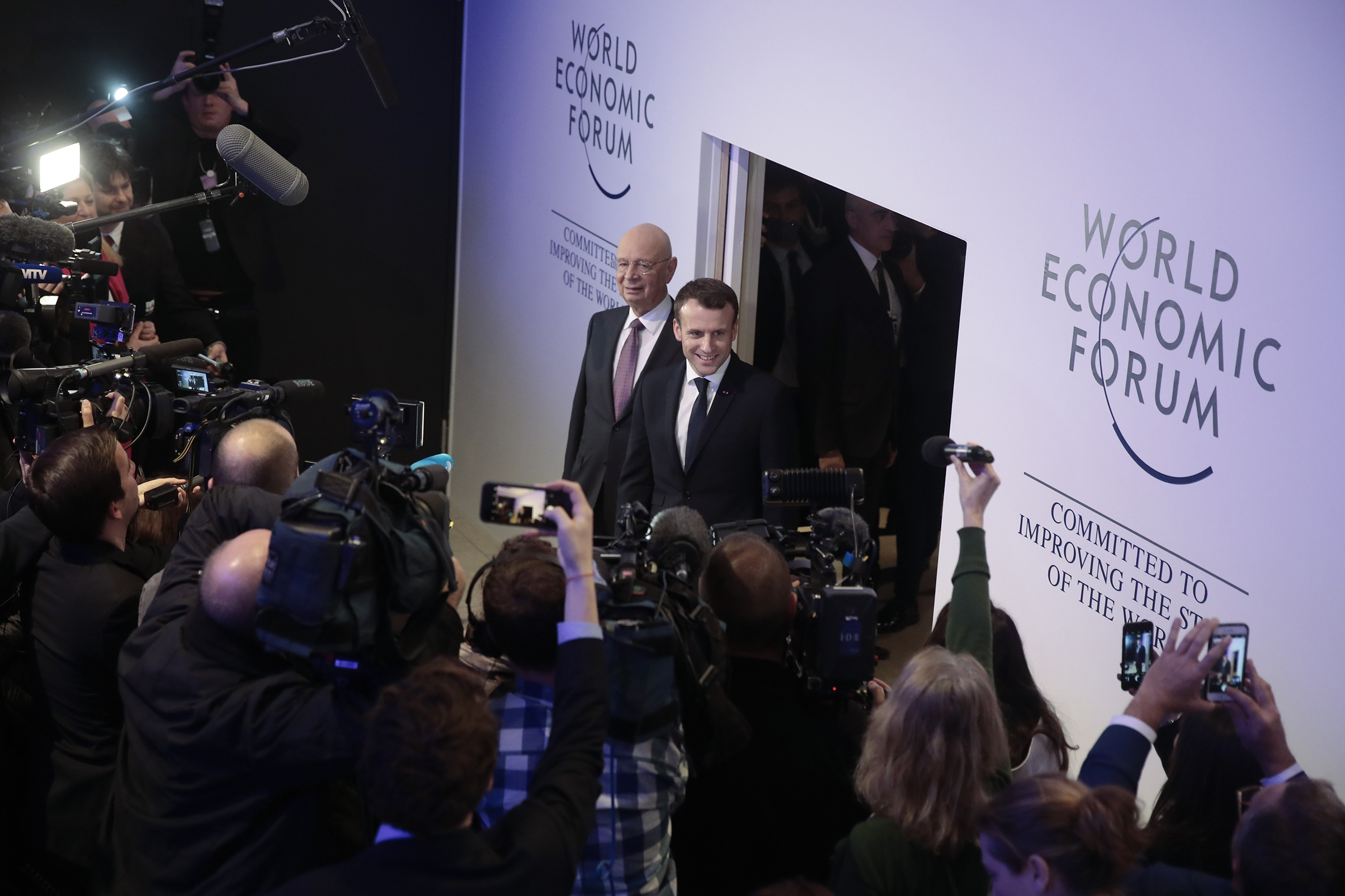 Klaus Schwab, left, executive chairman of the World Economic Forum, and French President Emmanuel Macron in Davos on Jan. 24