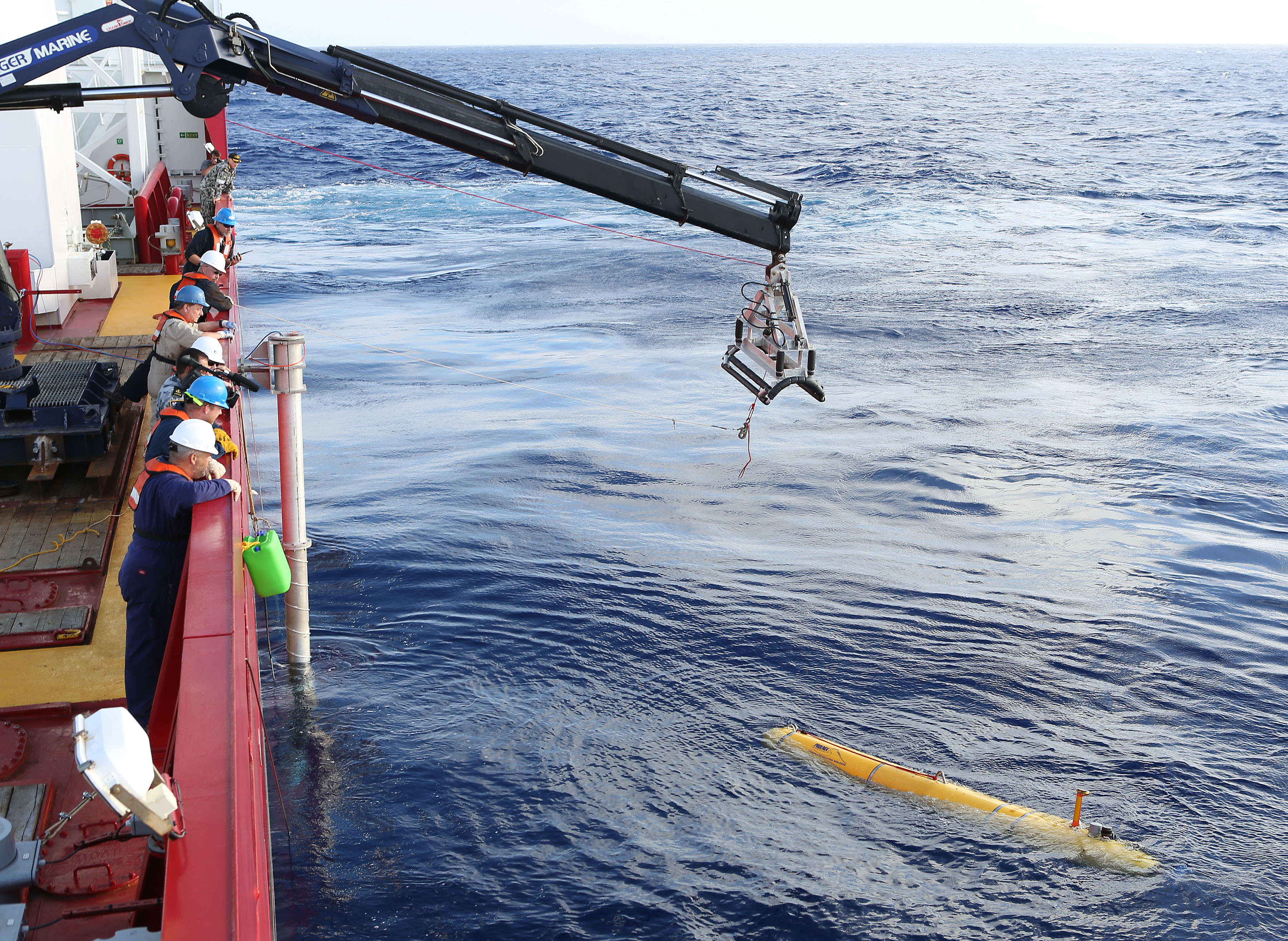 In this handout image provided by Commonwealth of Australia, Department of Defence, Phoenix Autonomous Underwater Vehicle (AUV) Bluefin-21 is craned over the side of Australian Defence Vessel Ocean Shield in the search for missing Malaysia Airlines flight MH 370 on April 14, 2014.
