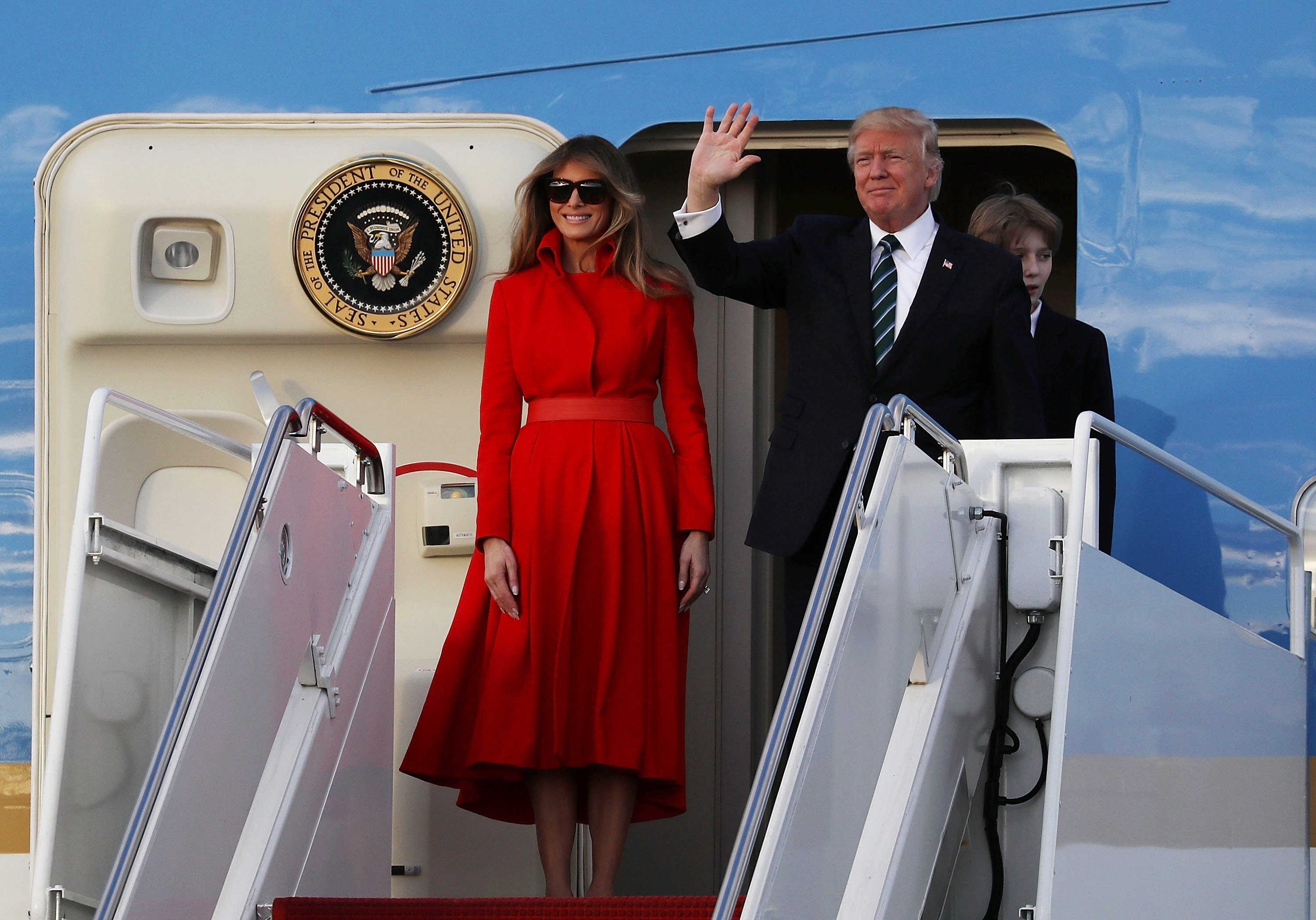 President Donald Trump, his wife Melania Trump and their son Barron Trump arrive together on Air Force One at the Palm Beach International Airport to spend part of the weekend at Mar-a-Lago resort on March 17, 2017 in West Palm Beach, Florida