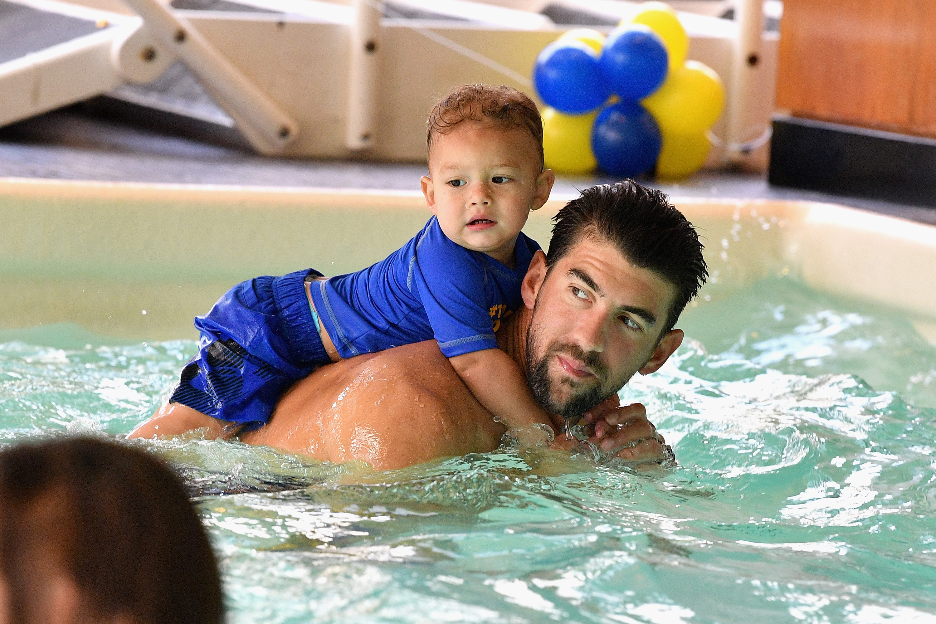 Boomer Phelps and Michael Phelps attend the Huggies Little Swimmers #trainingfor2032 Swim Class With The Phelps Foundation on August 21, 2017 in New York City.
