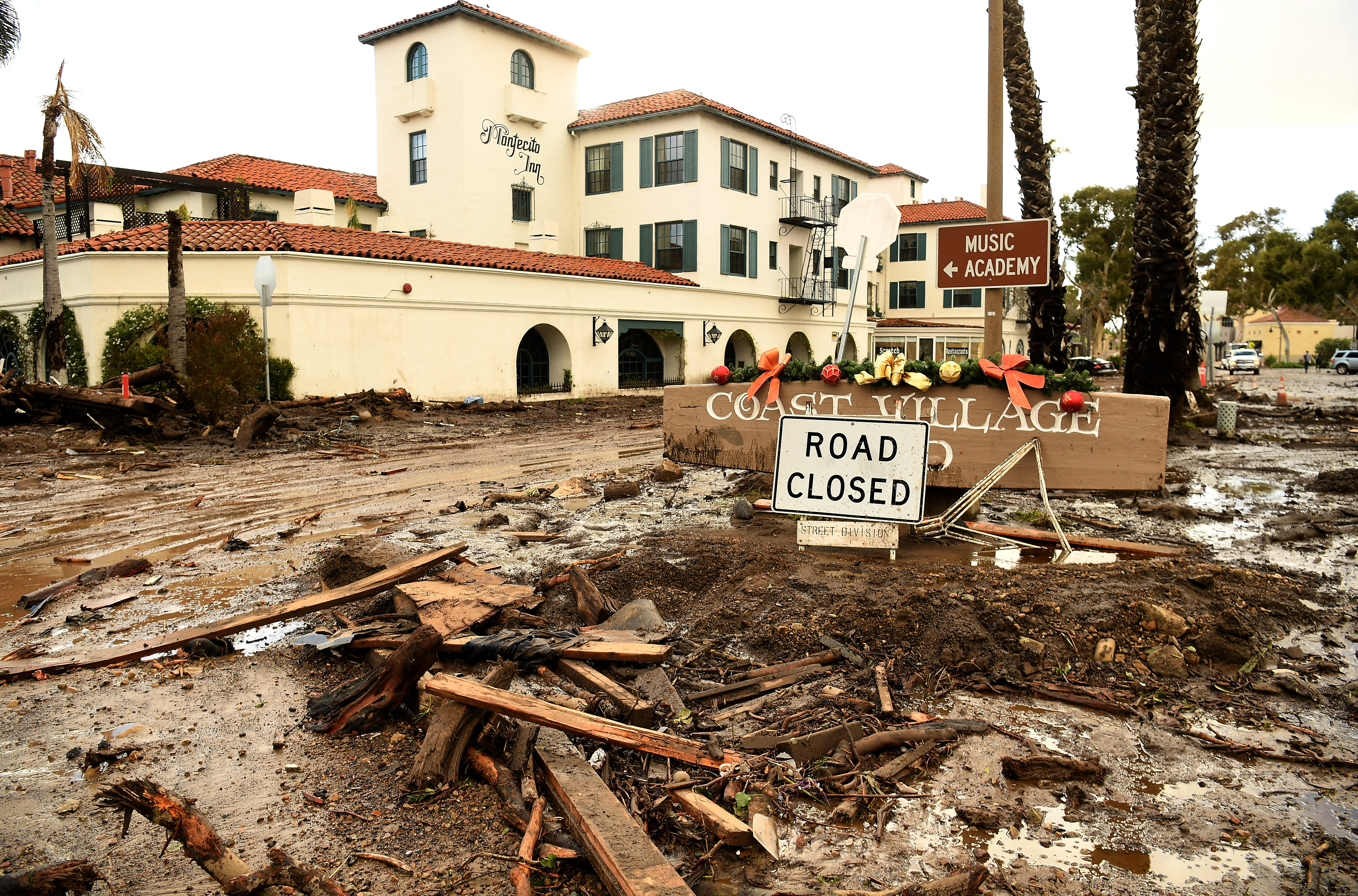 Mud and debris gather outside the Montecito Inn along Olive Mill Road in Montecito after a major storm hit the burn area January 9, 2018 in Montecito, California.